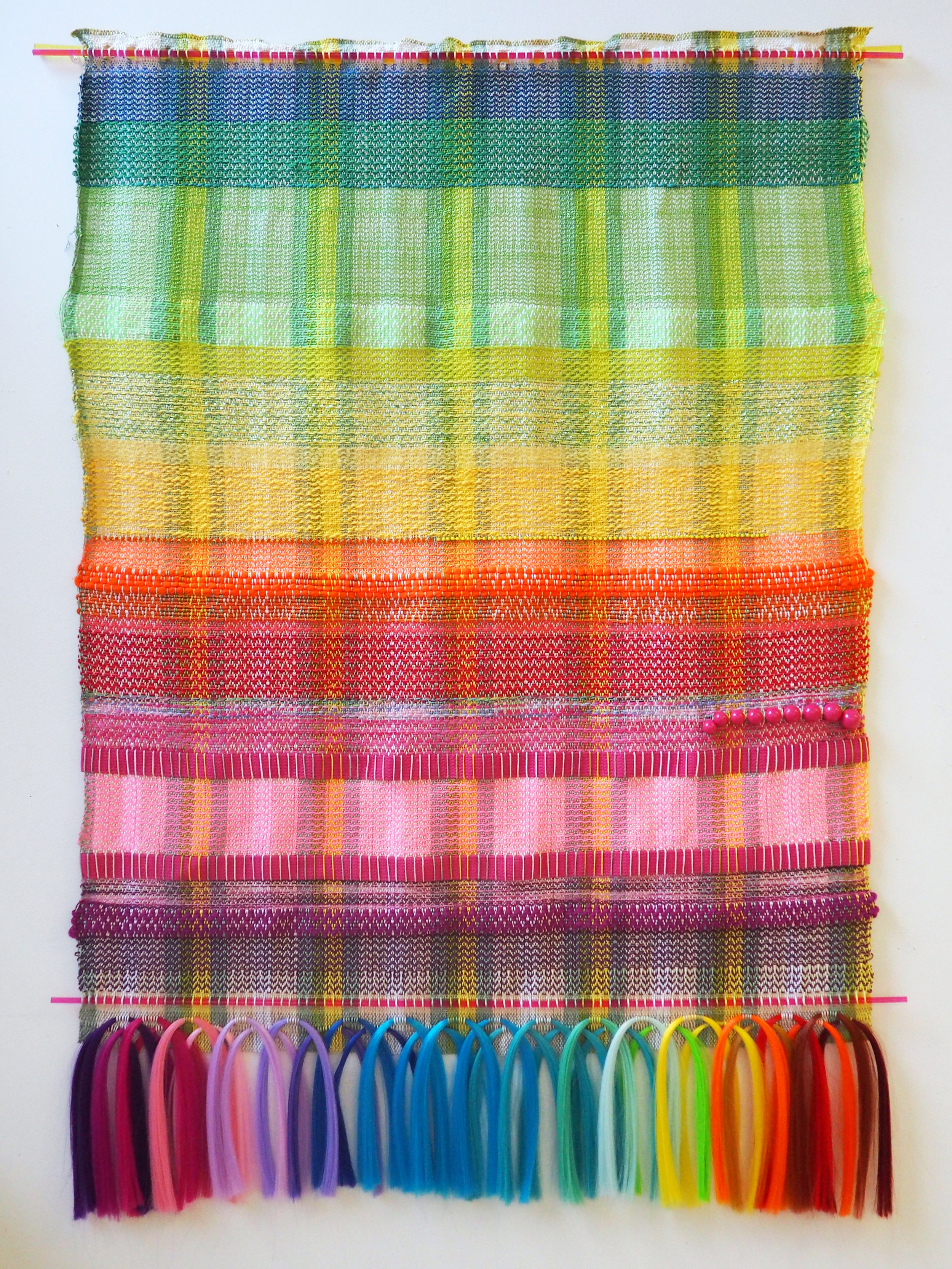 Handwoven tapestry- Mixed yarns, plastic, glass, synthetic hair, and beads. 47 x 36 in 2017