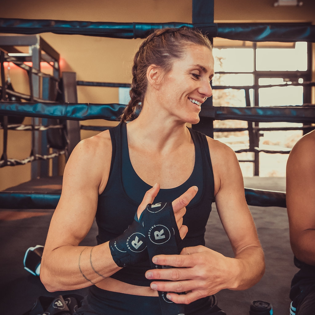 """COACH MG - Hometown: Santaquin, UtahWhy Boxing?: Boxing pushes me harder than anything else I've done. It engages me mentally and physically, and it has taught me a lot about my limits - or rather, how limitless I am.How do you RISE?: I RISE by pushing to be my best self and encouraging others to do the same. Nothing fuels me more than the process of working towards big goals and watching the """"impossible"""" become possible.How do you help other RISE?: I love sharing my passion with others. I hope to help others fuel a life full of belief - belief in themselves that they are capable of anything and that hard work is the road to any success.Pursuits outside of boxing?: Wait, there is life outside of boxing??#1 Song to box to: Personally, I train in silence most of the time. I like to focus and find my flow."""