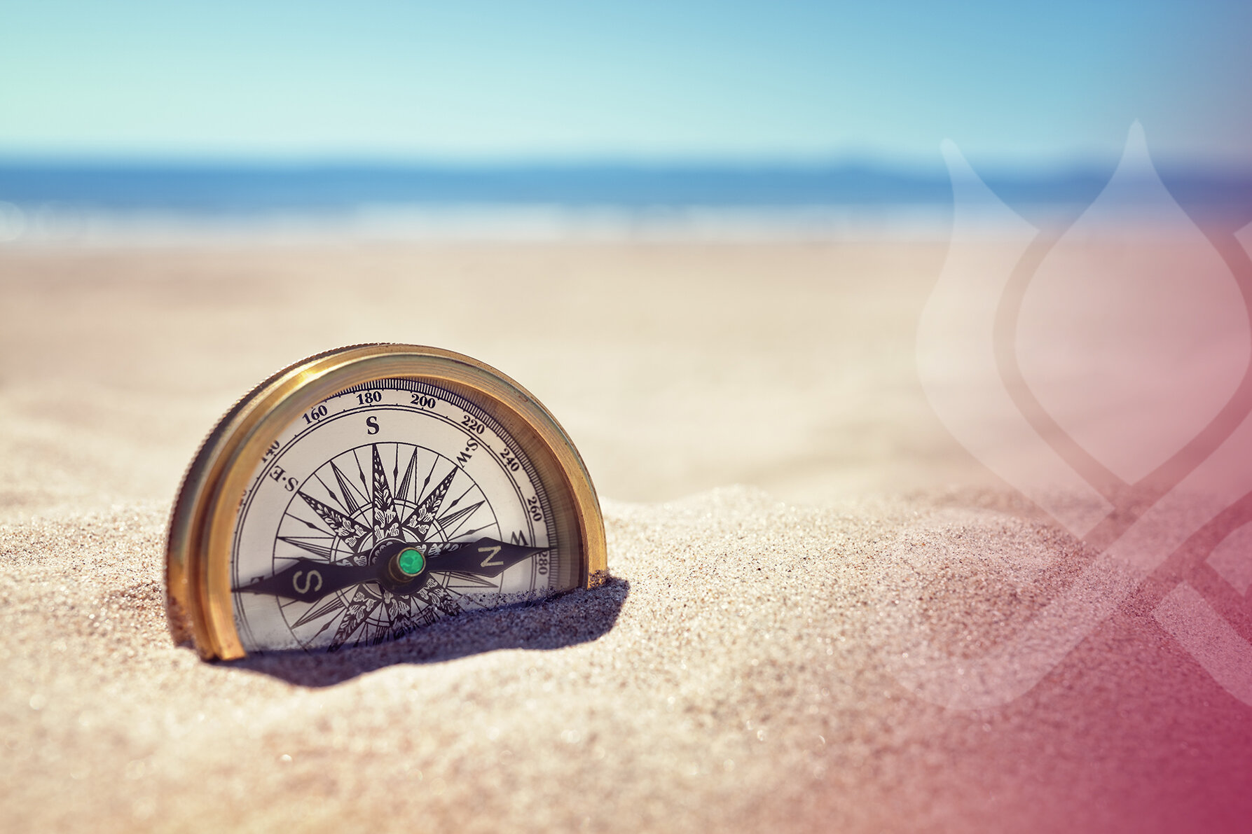 Blog-compass-on-the-beach-with-sand-and-sea.jpg