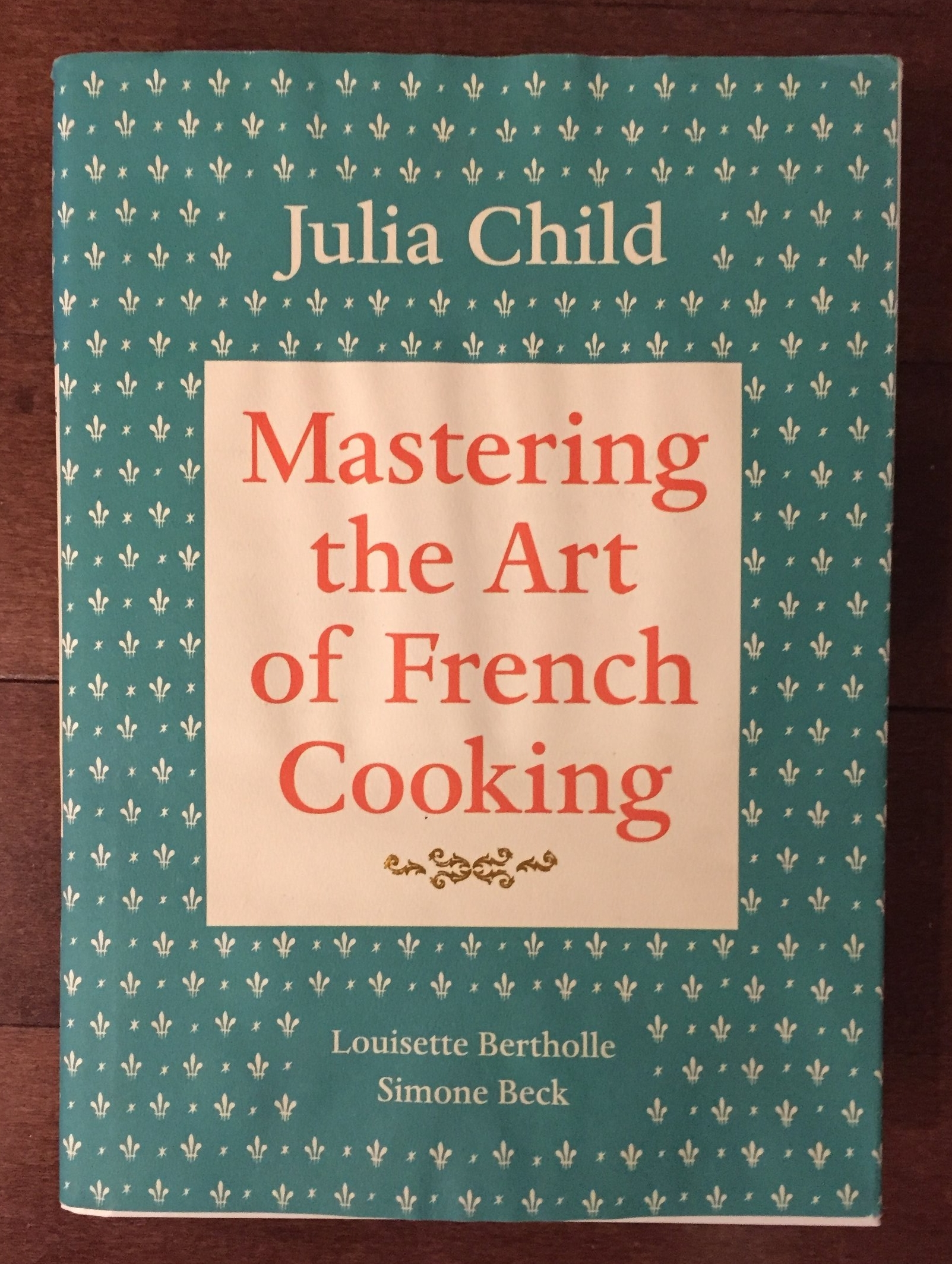Mastering the Art of French Cooking. Yes of course it made the list. It's the famous Julia Child's book, also written by Louisette Bertholle and Simone Beck. This book was intended to introduce American's to French Cooking. With such recipes like beef bourguignon, bouillabaisse, and cassoulet. I definitely watched the movie Julie and Julia and then bought this book.