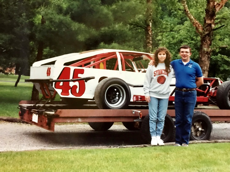 Laura and her dad with one of his stock cars. Photo: Laura Pierce