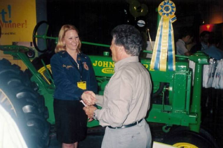 Tabatha, 15, meeting Mario Andretti after winning the tractor restoration contest.