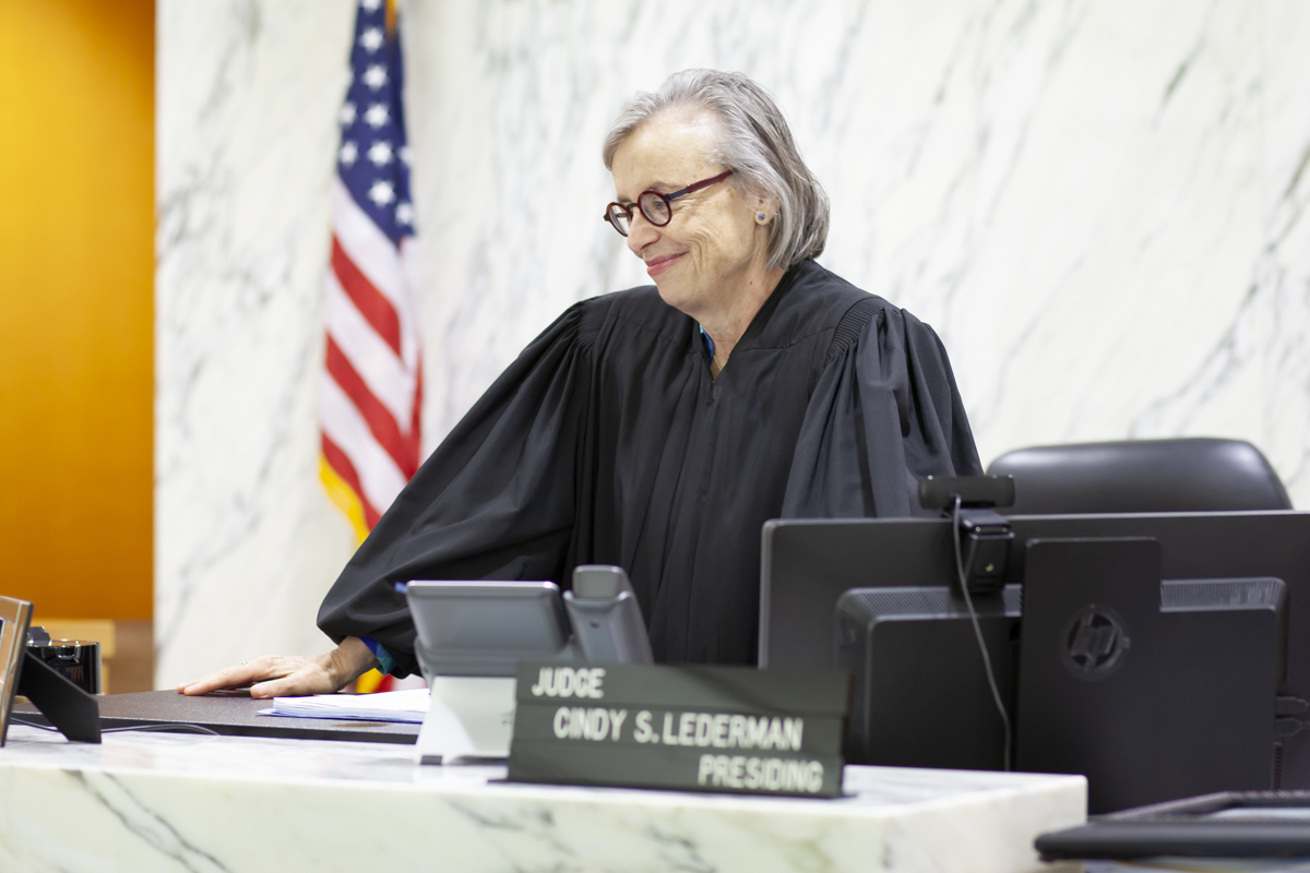Judge Cindy Lederman smiling during an adoption in Miami Children's Courthouse