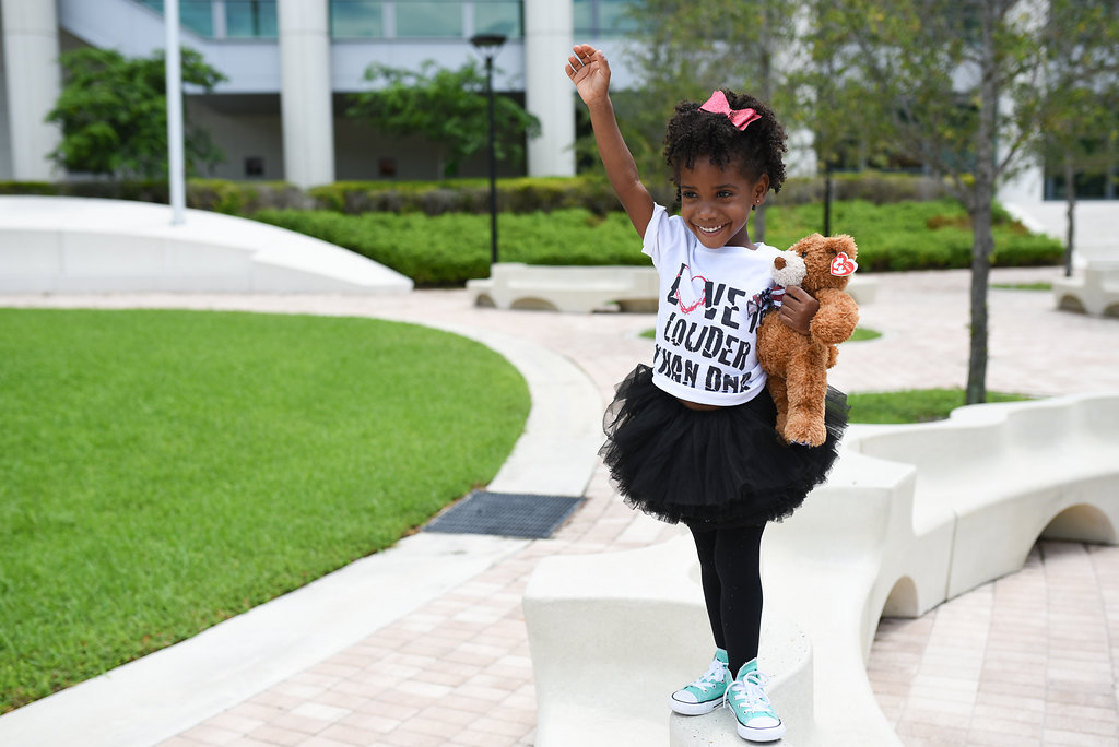 My daughter, excited at her adoption day in Miami Children's Courthouse  Photography by Alex Rodriguez