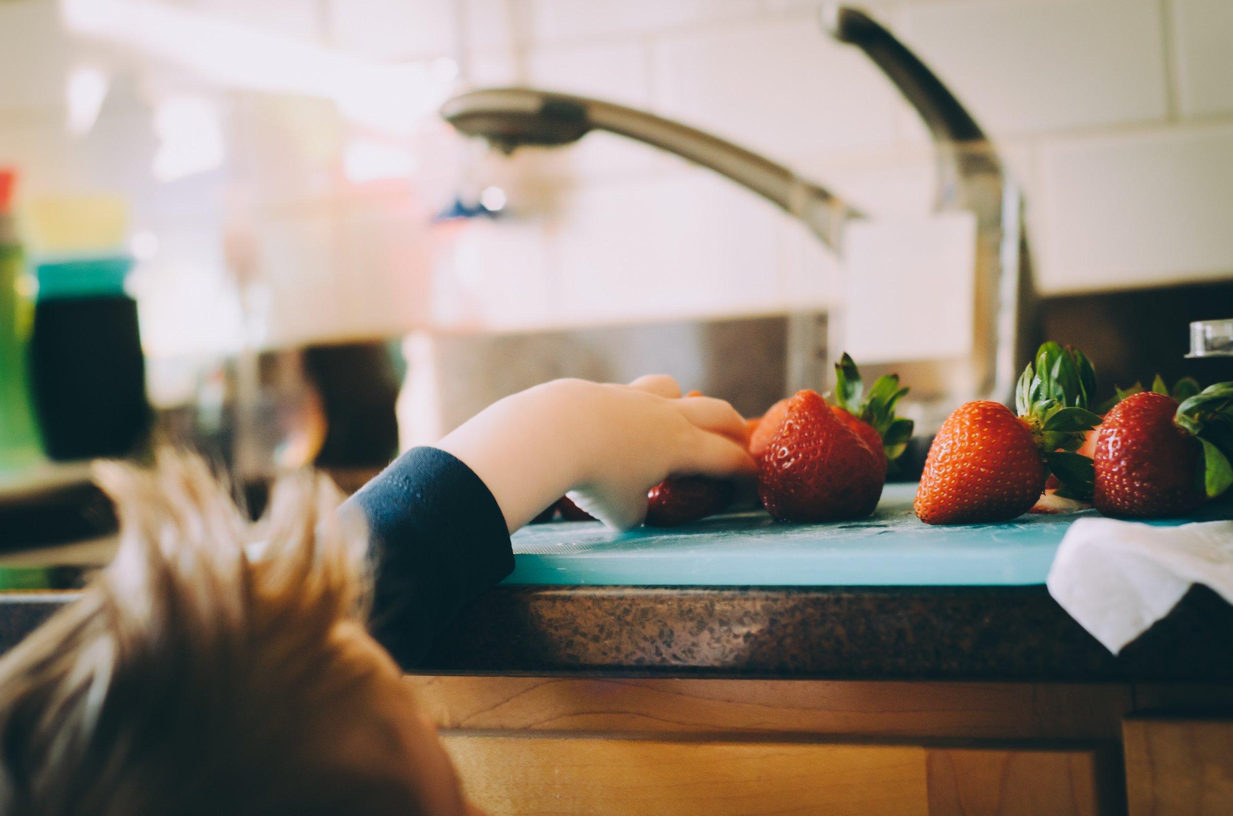 Child-eating-strawberries-hungry.jpg