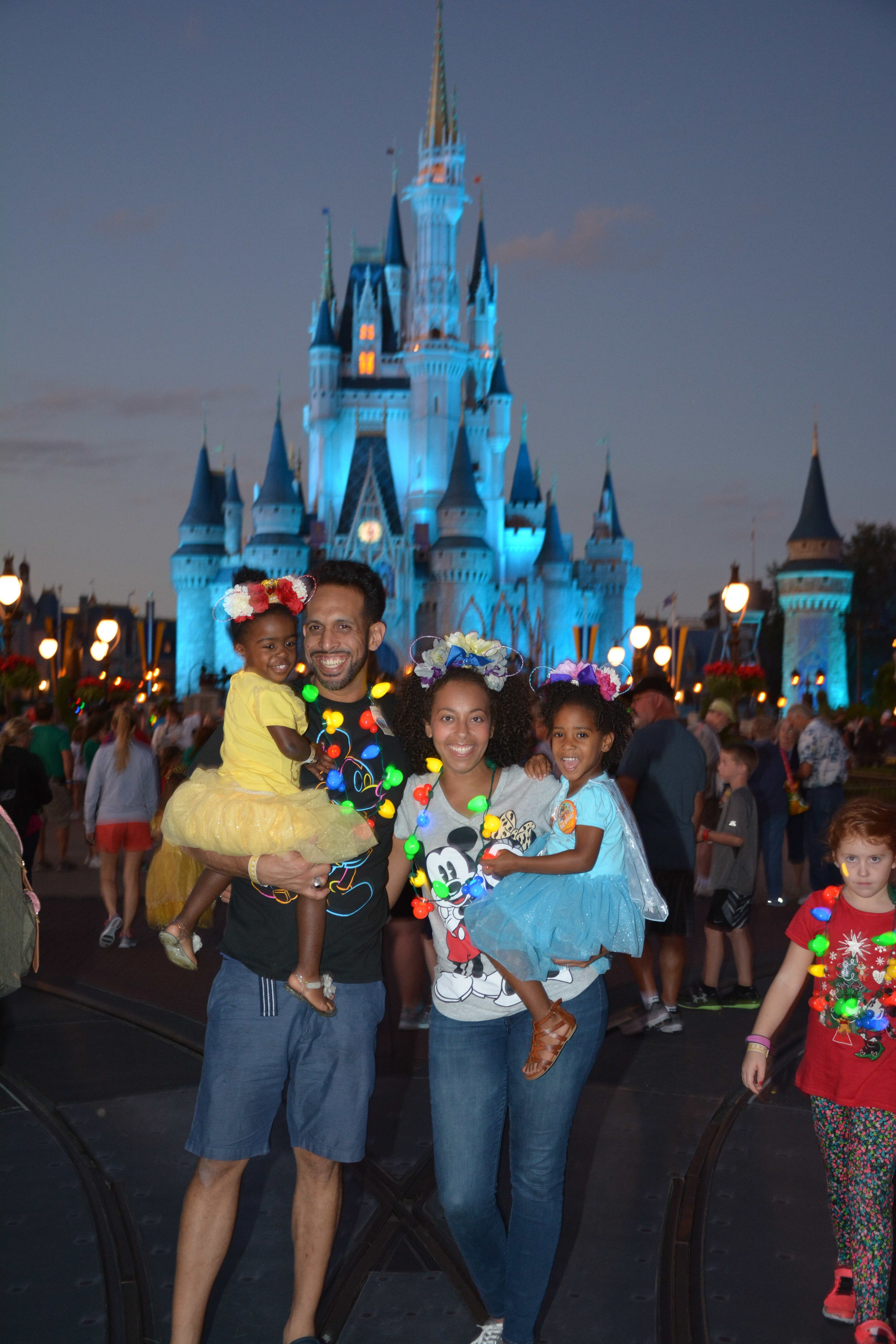 Family-by-cinderellas-castle-taking-pictures-to-celebrate-adoption-day