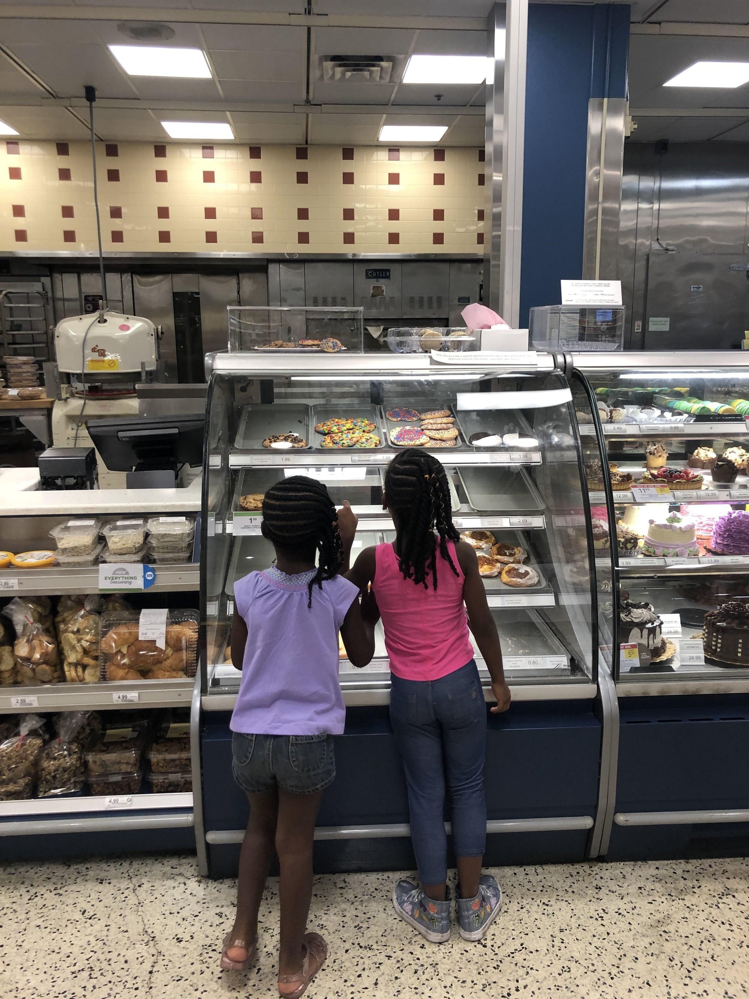 Getting their free cookies at  Publix