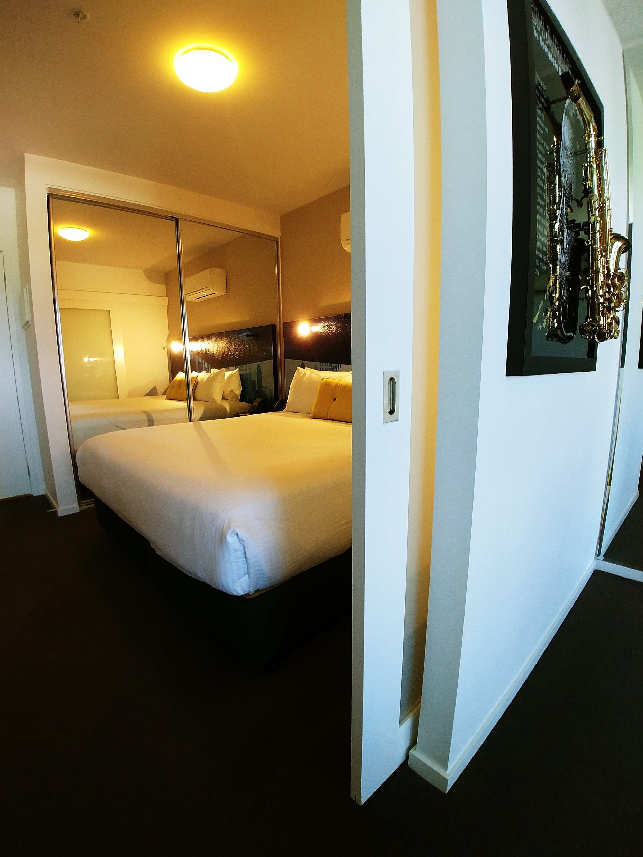 The bedroom is situated between the ensuite bathroom and the lounge.