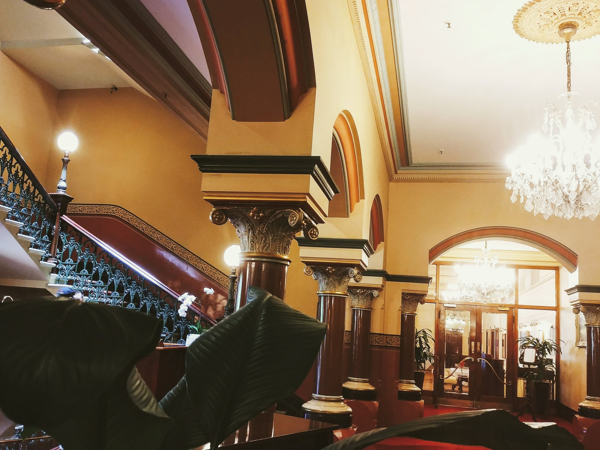 Lobby with the grand staircase, grand piano and towards the grand ballroom