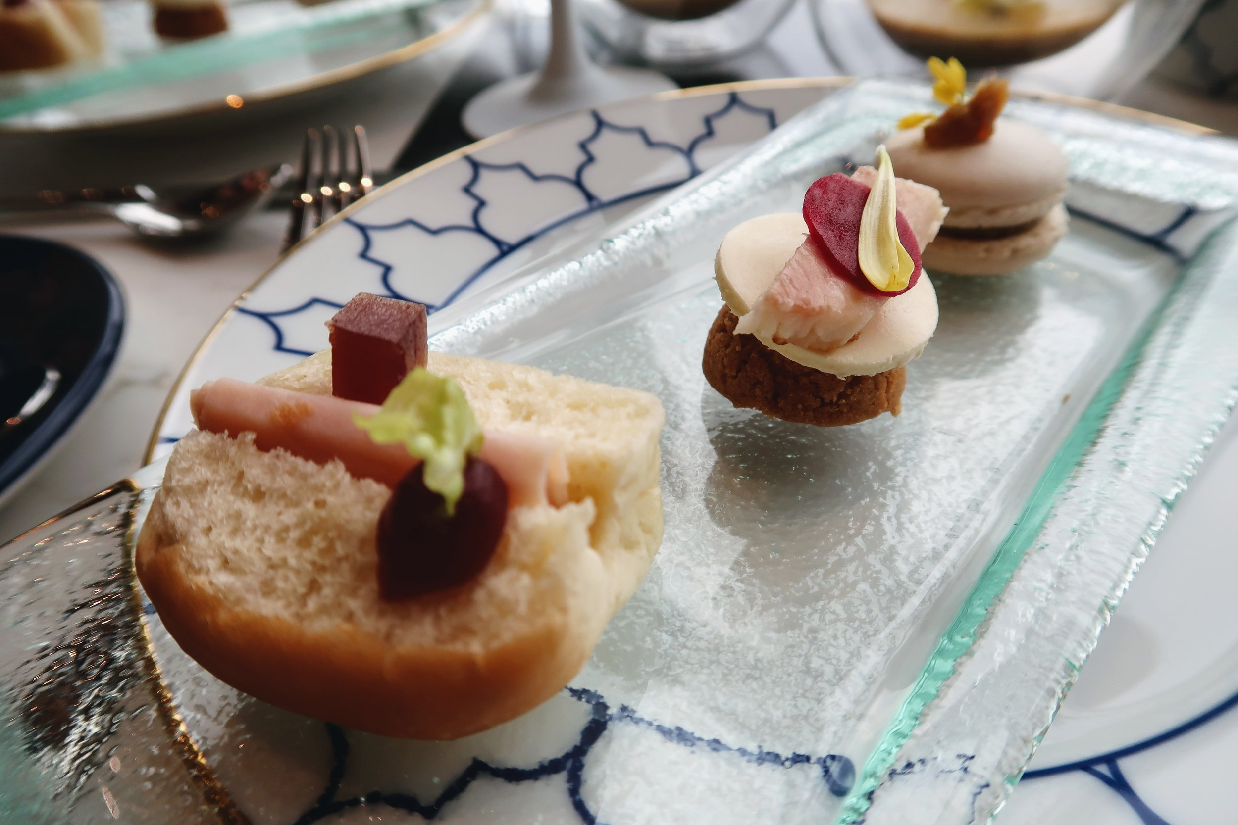 Left to right: Smoked Christmas turkey breast sandwich with cranberry sauce, smoked eel with horseradish mousse and truffle mushroom macaroon.
