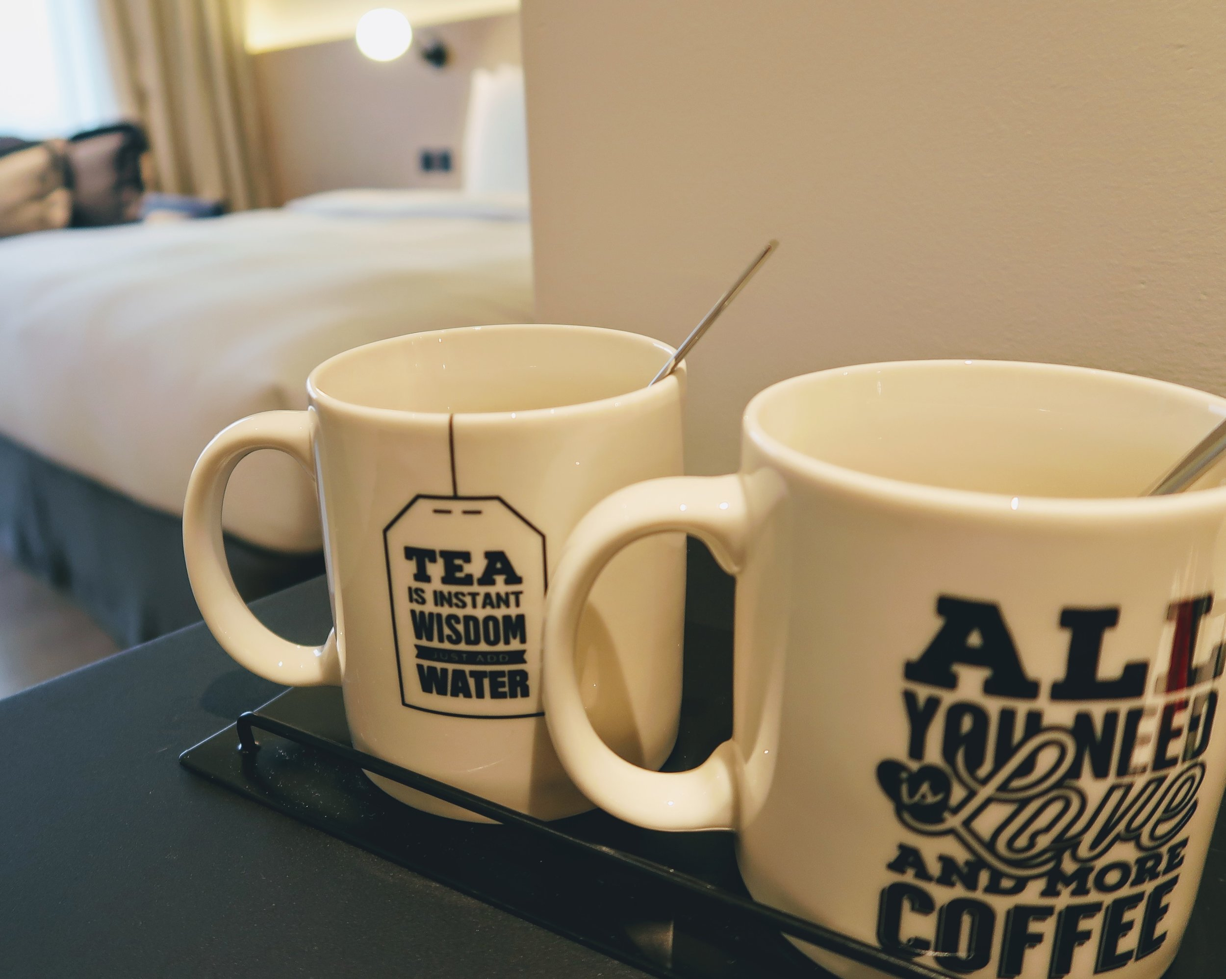 Love their coffee and tea cups in the room! I love it how one is for coffee and one is for tea in case one person doesn't drink the other. How thoughtful and cute!