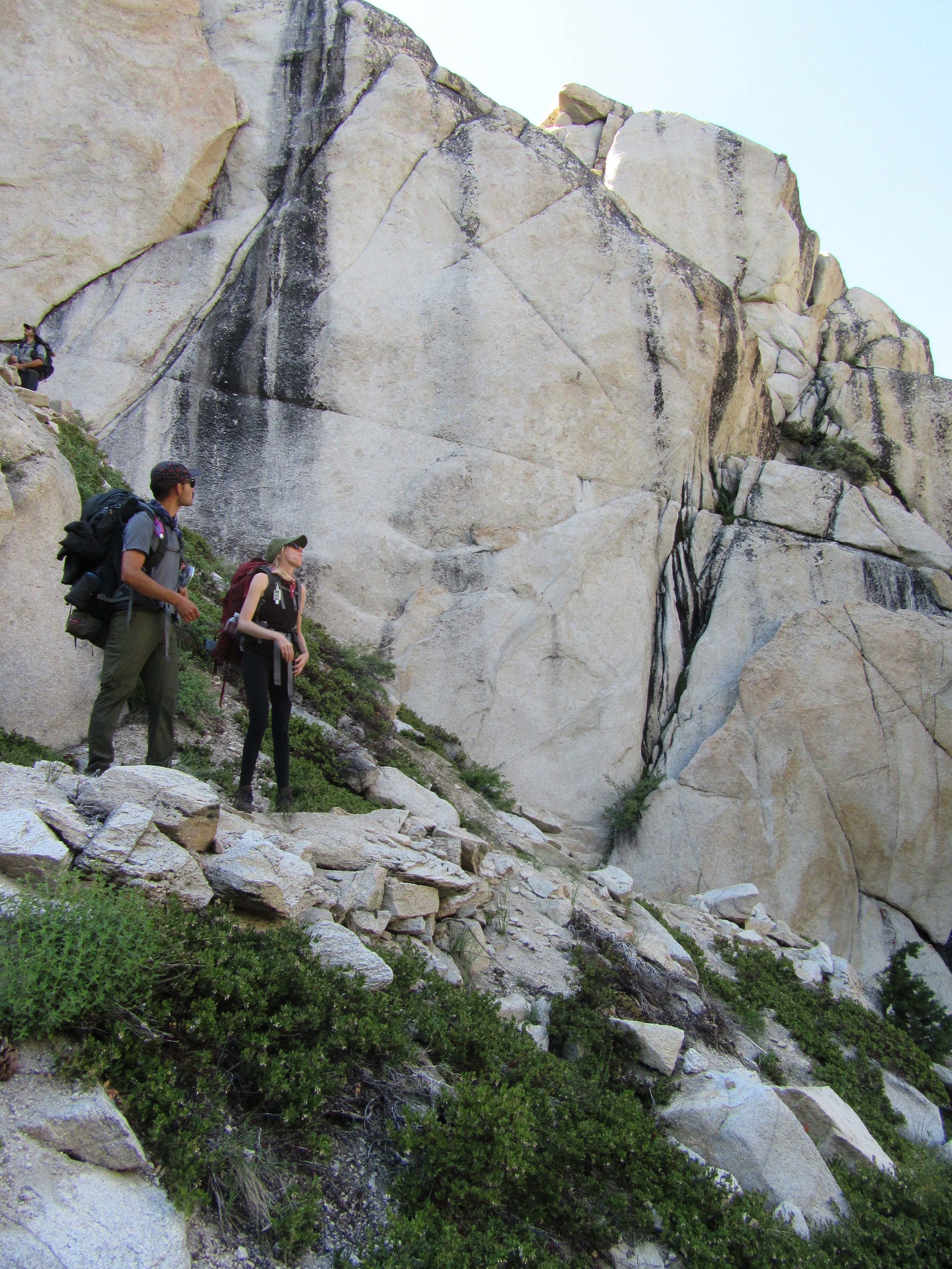 Joel and Nicole standing on a series of switchbacks between Barney and Peeler Lakes