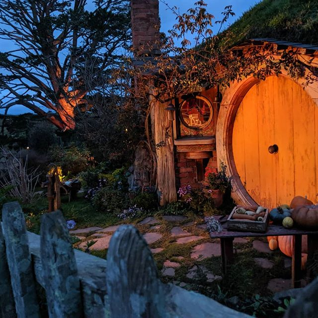MF Hobbiton, y'all!!!! Arguably a must on any trip to New Zealand--especially all you Lord of the Rings fans out there. You feel me right?! . . So we didn't do this probably the best way but it worked out for us. Get this: so we arrived in New Zealand, we got word that the best way to experience Hobbiton was to do the evening Banquet Tour. Basically, it's done at sunset and includes a banquet feast fit for a Hobbit. Awesome right?! Well evidently those tours get booked about a year out. But we called anyway. By luck we managed to squeeze the last two spots. But our luck didn't stop there. We showed up and it turns out that a bus of 50 tourists that were supposed to be on our tour, weren't going to be able to make it. Seriously! What luck?! . . It was amazing to see the set and walk among the Hobbit houses and hear the stories from the locals that now take care of it for posterity. It's owned by the Alexander family--a local shepherding family who's owned the land for years. Well back in 1999, Peter Jackson's team spots the farm during an aerial location search and approaches the Alexander family - unfortunately, they knocked on the door while the family were watching an international test rugby match and were told to go away and wait! Eventually they were given an audience, a contract was signed and history was made. . . Hilarious. We loved every minute. Such an incredible, pinch-me type of moment. . . #hobbiton #peterjackson #newzealand #purenewzealand #movieset #lordoftherings #lotr #fellowshipofthering #pinchme #traveller  #hobbithouse #hobbit
