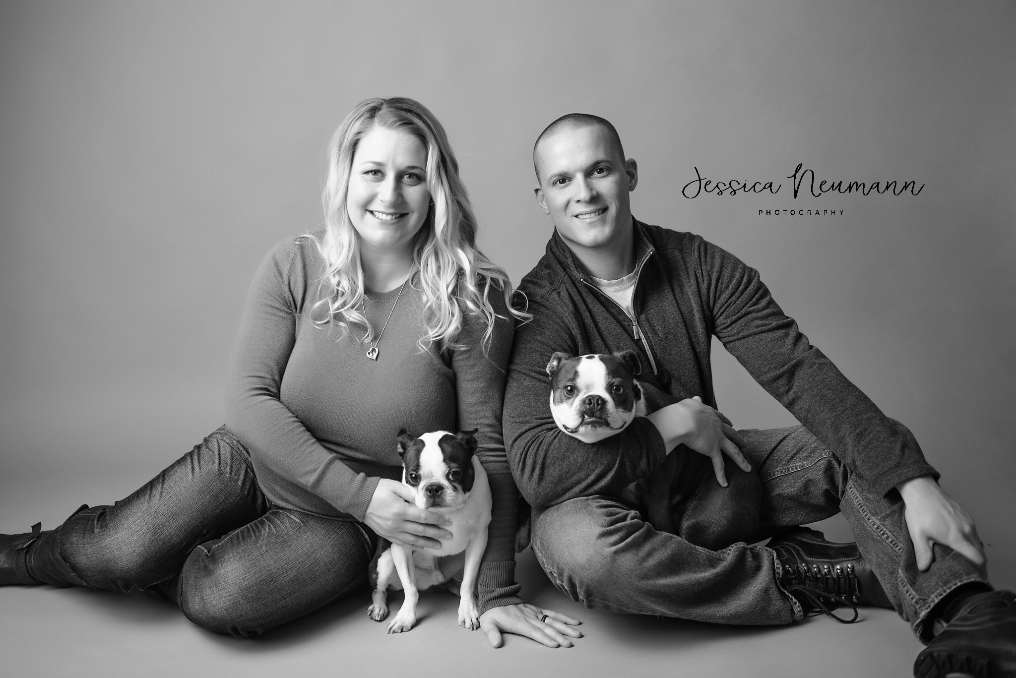 Black and white pregnant couple with dogs in Frederick, MD