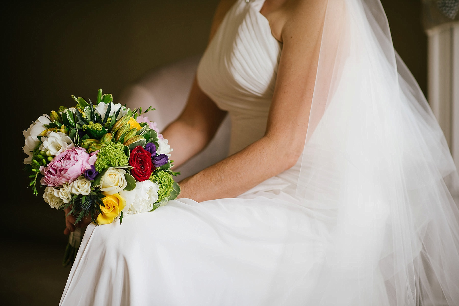 close up of the wedding flowers and dress