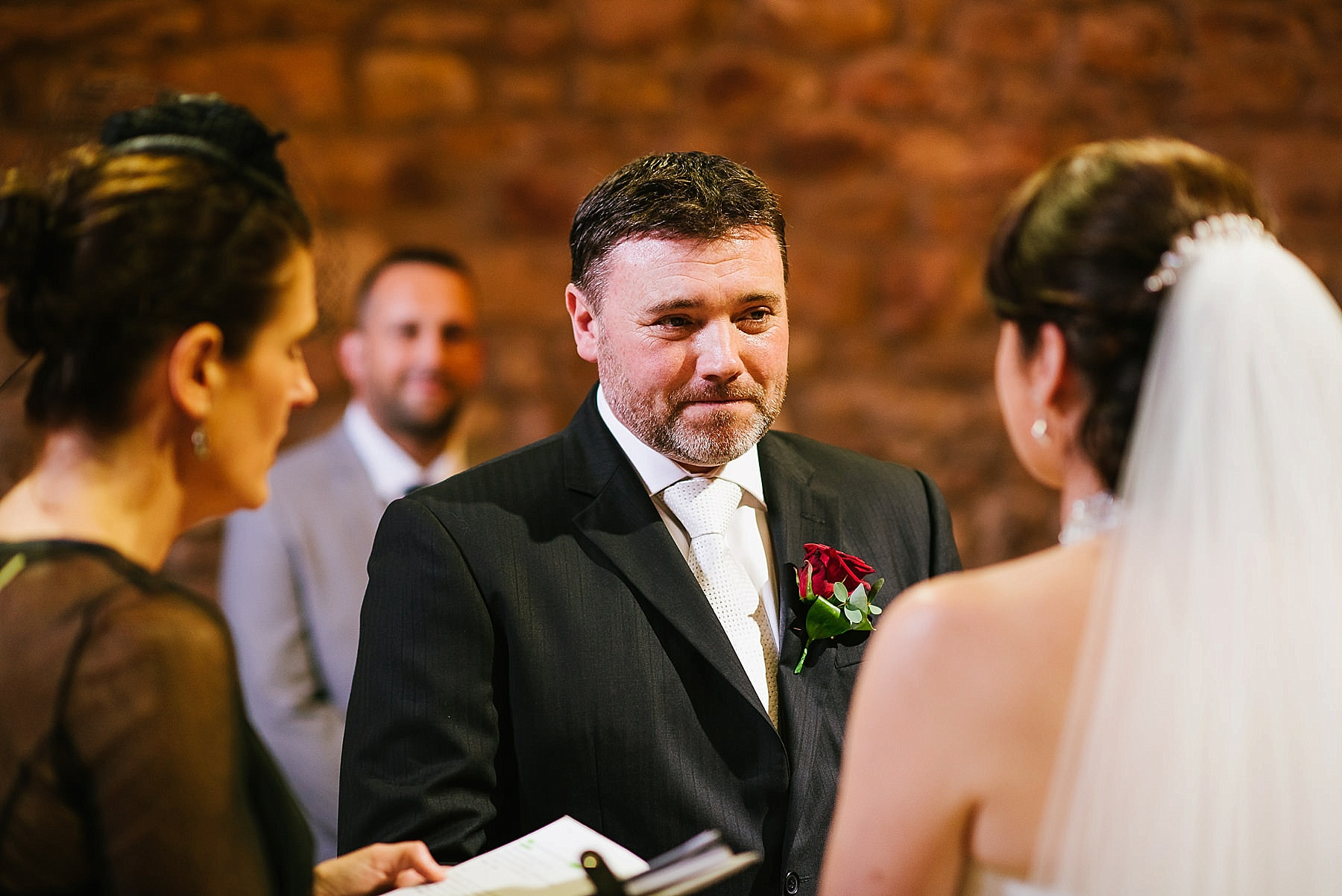 Groom looking at bride during the ceremony