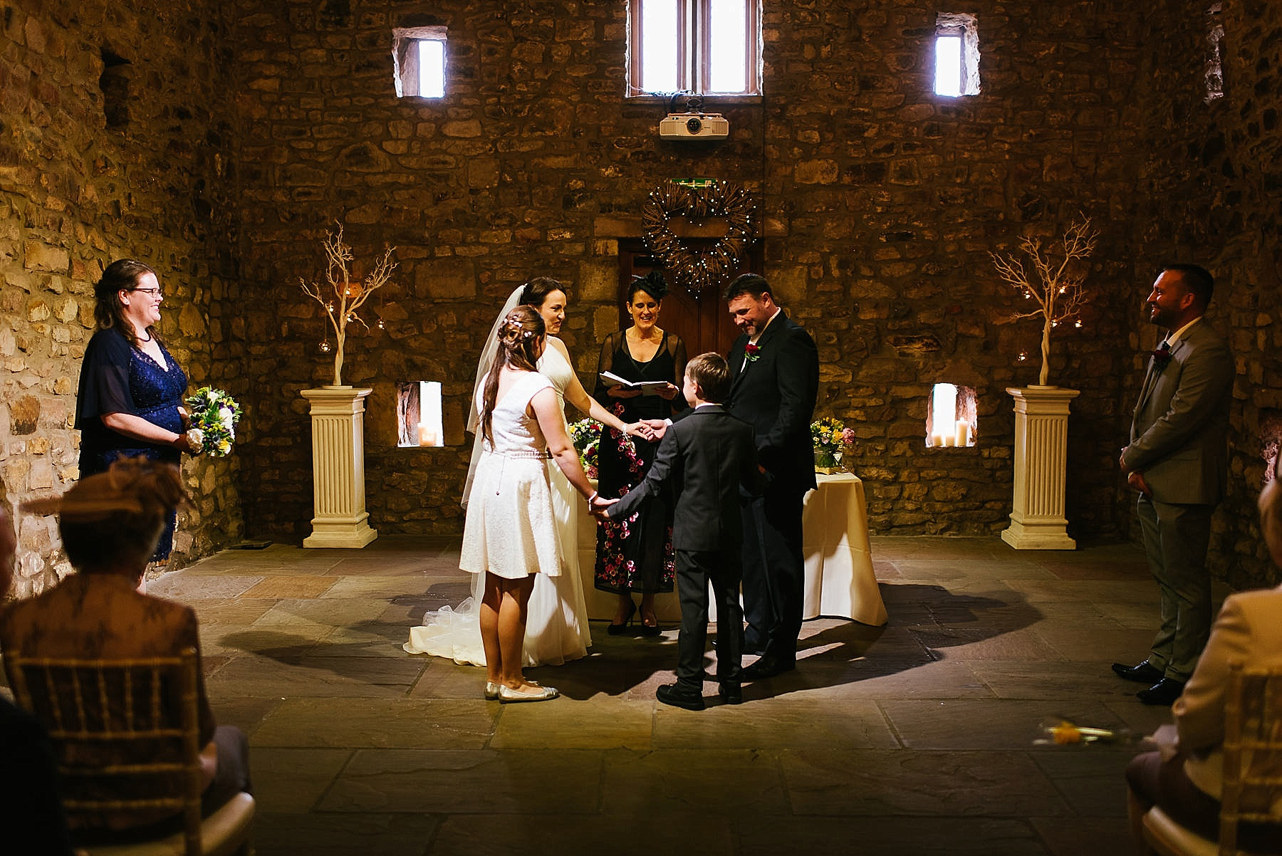 humanist nuptials with wedding party holding hands