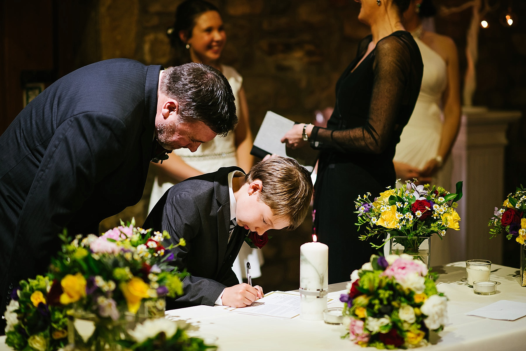 Grooms son signing register