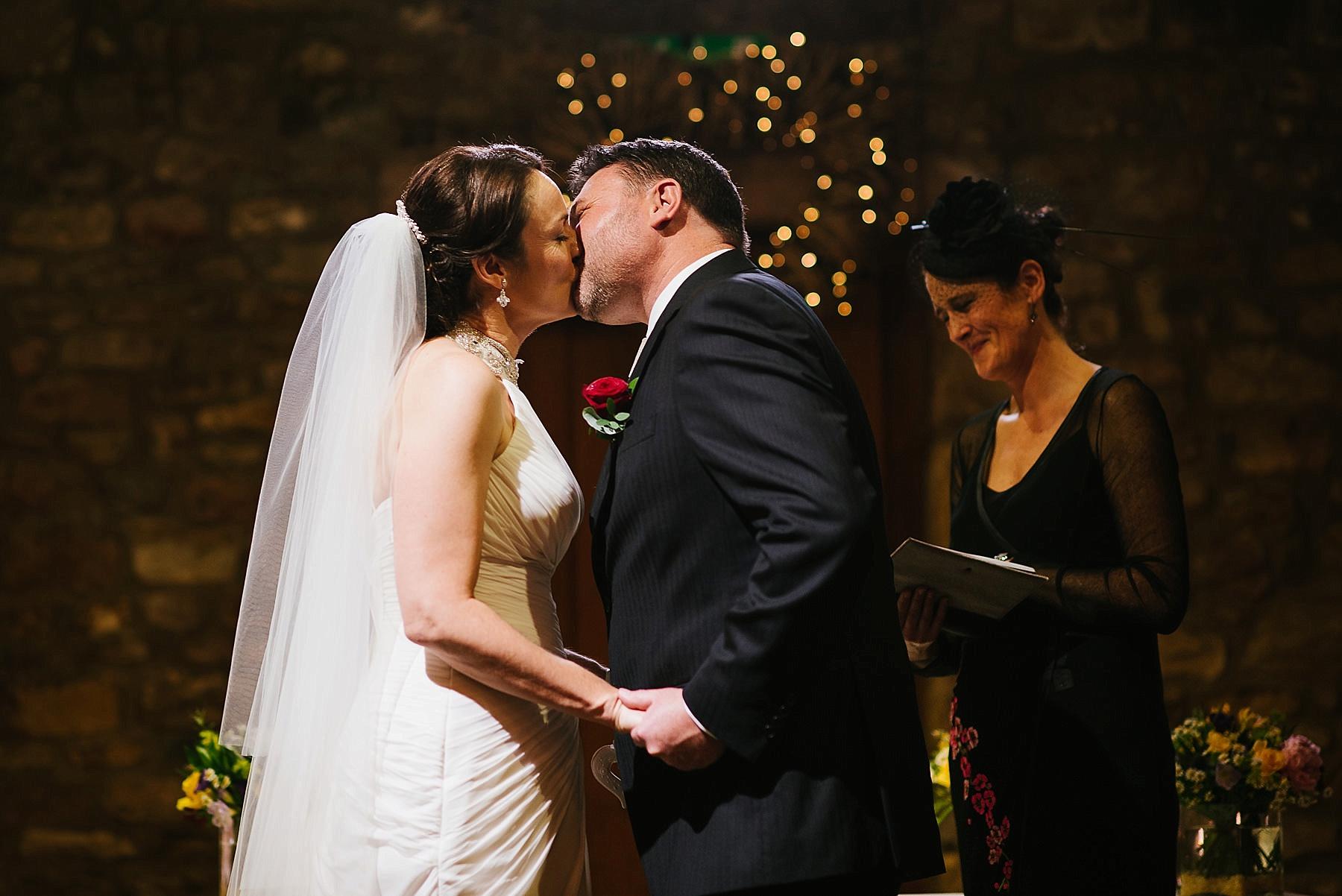 bride and groom having kiss