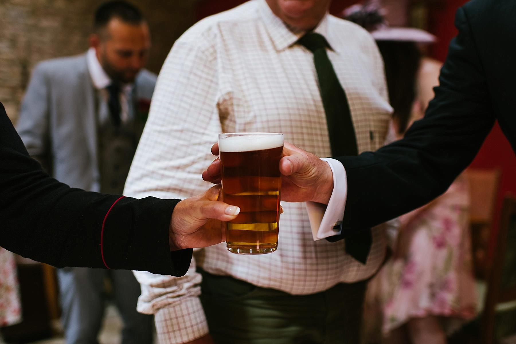 handing over a pint of beer
