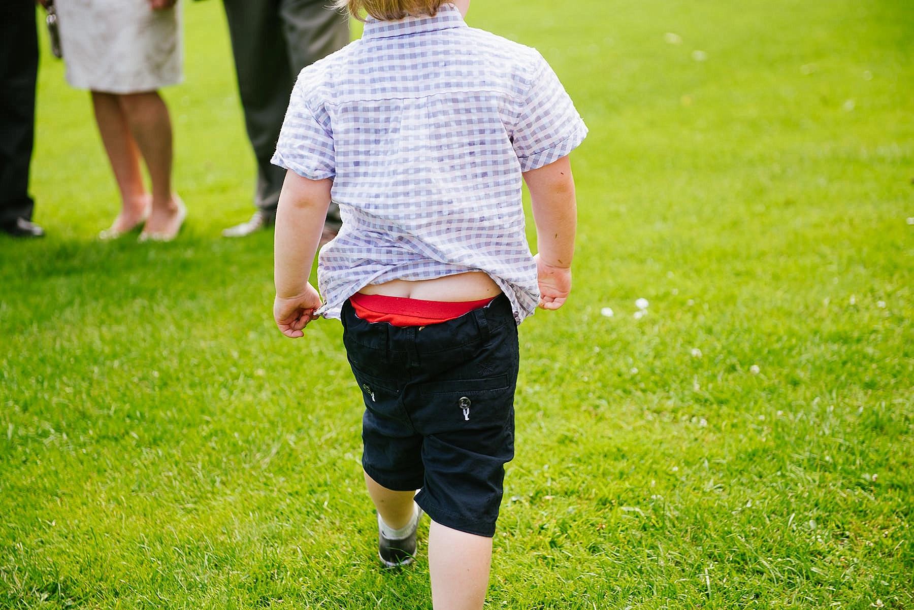 fun shot of child with shorts falling down