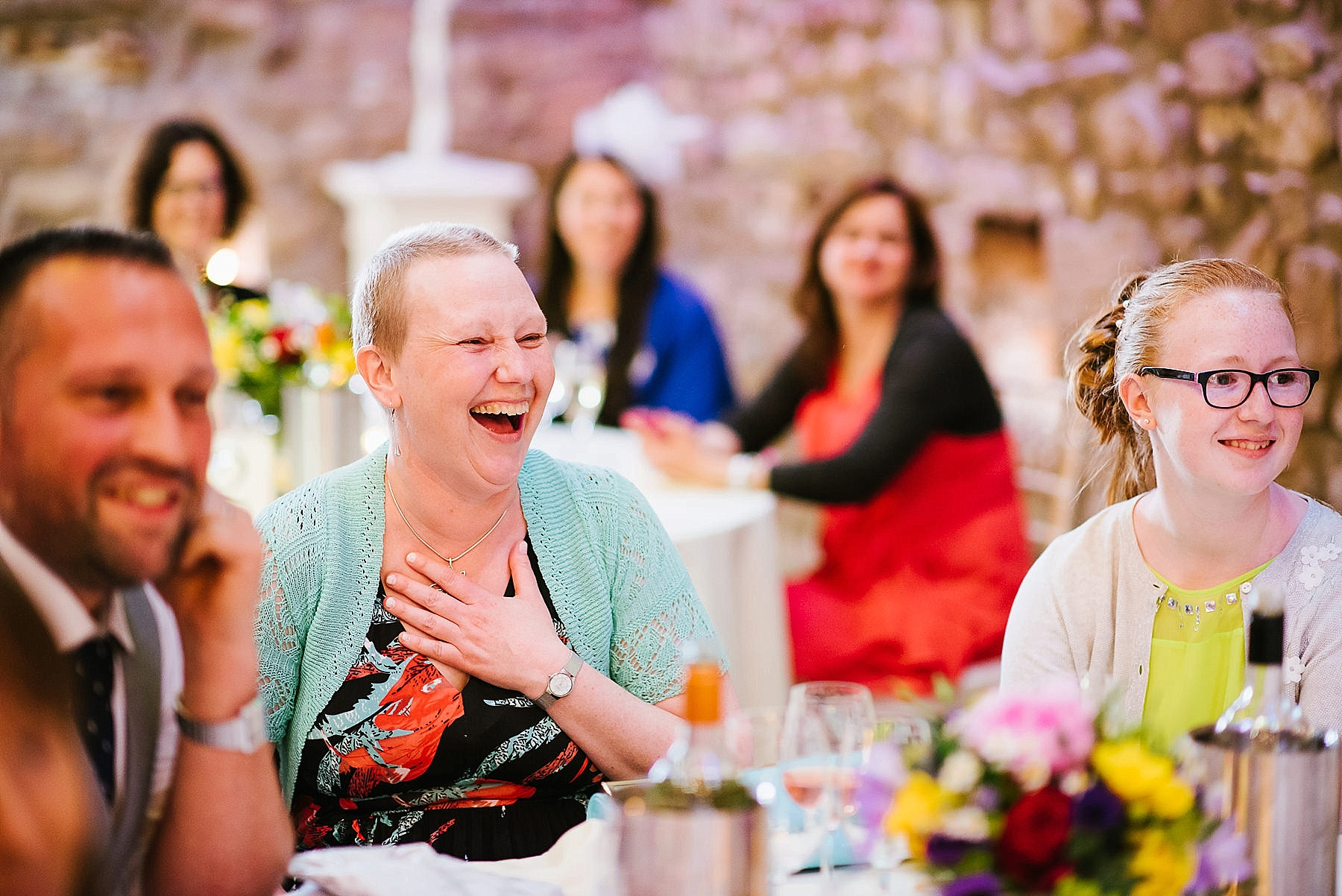 sister recovering from cancer smiling at wedding reception