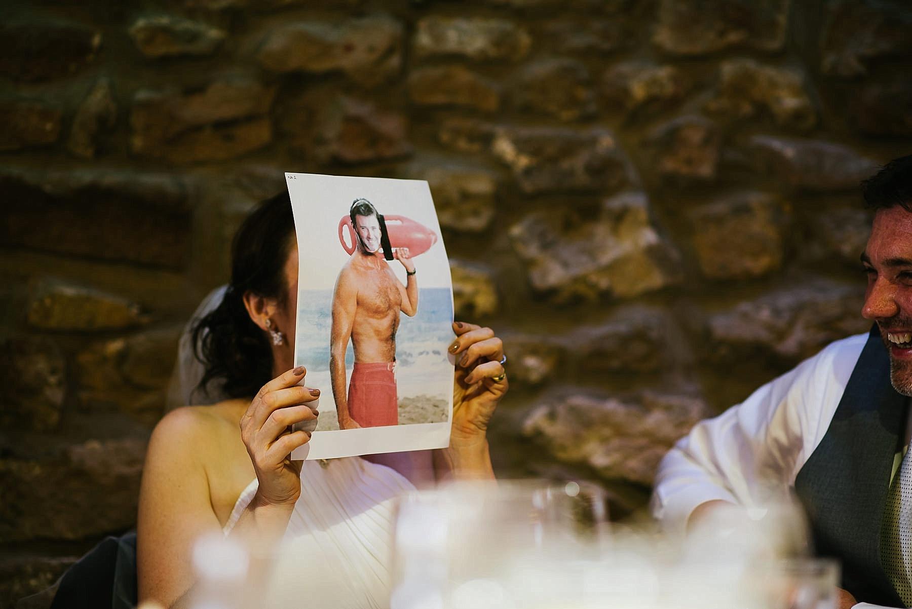 bride hiding behind baywatch photo