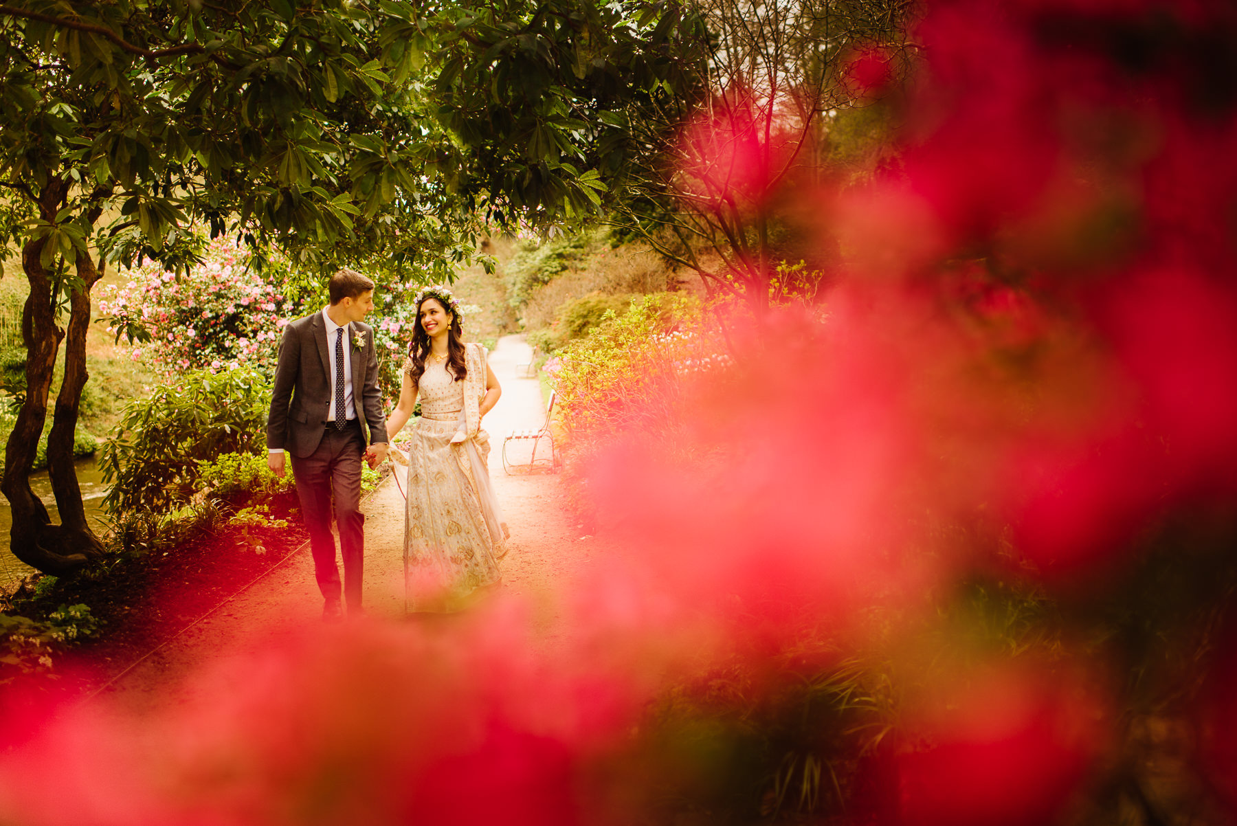 A Wedding portrait of Zara and Jared in the fabulous garden at  Quarry Bank Mill  in Manchester