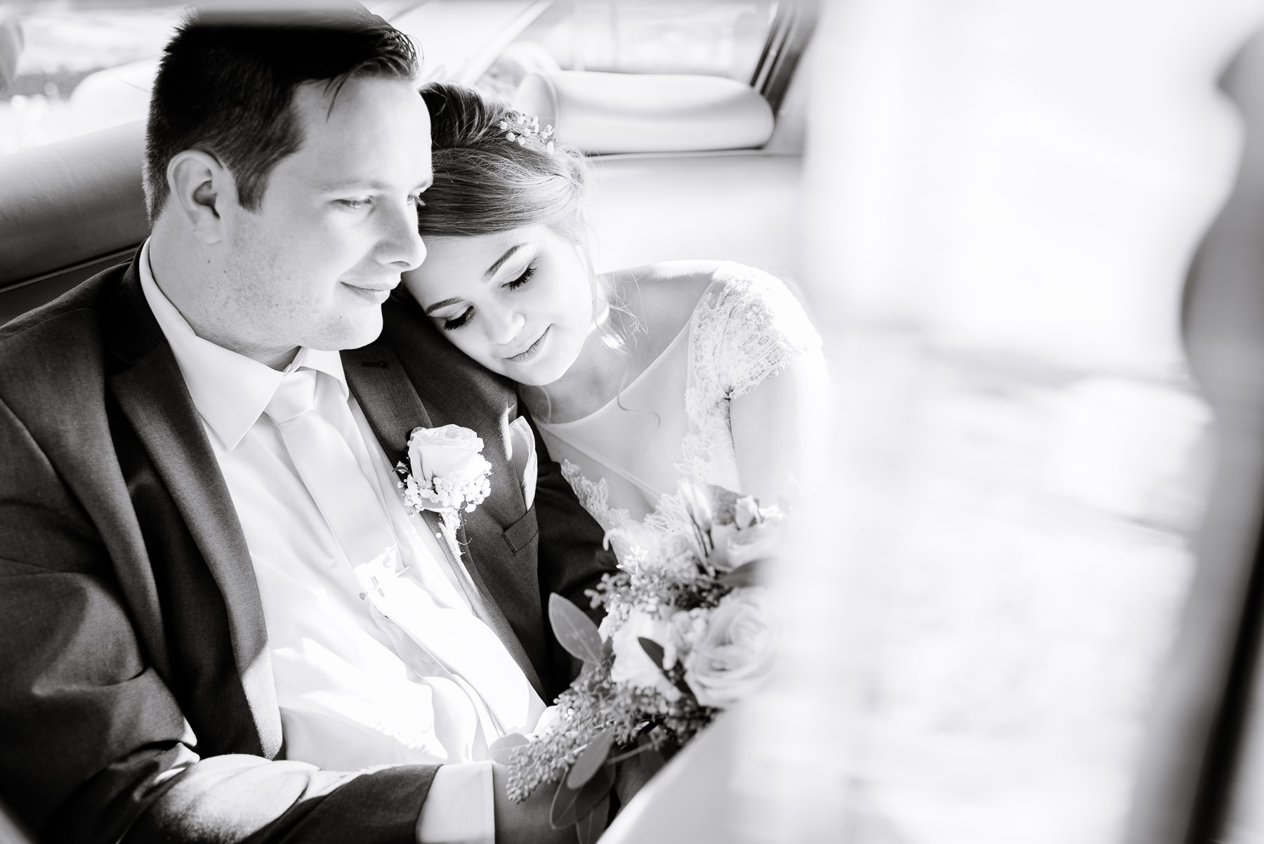 Bride and Groom in their wedding car at the Alma Inn, Burnley