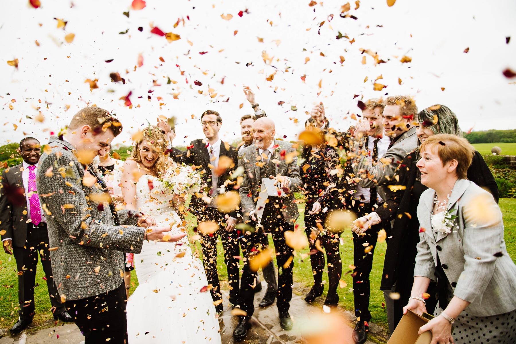 Incredible confetti moment at Jack and Emmas wedding at Beeston Manor