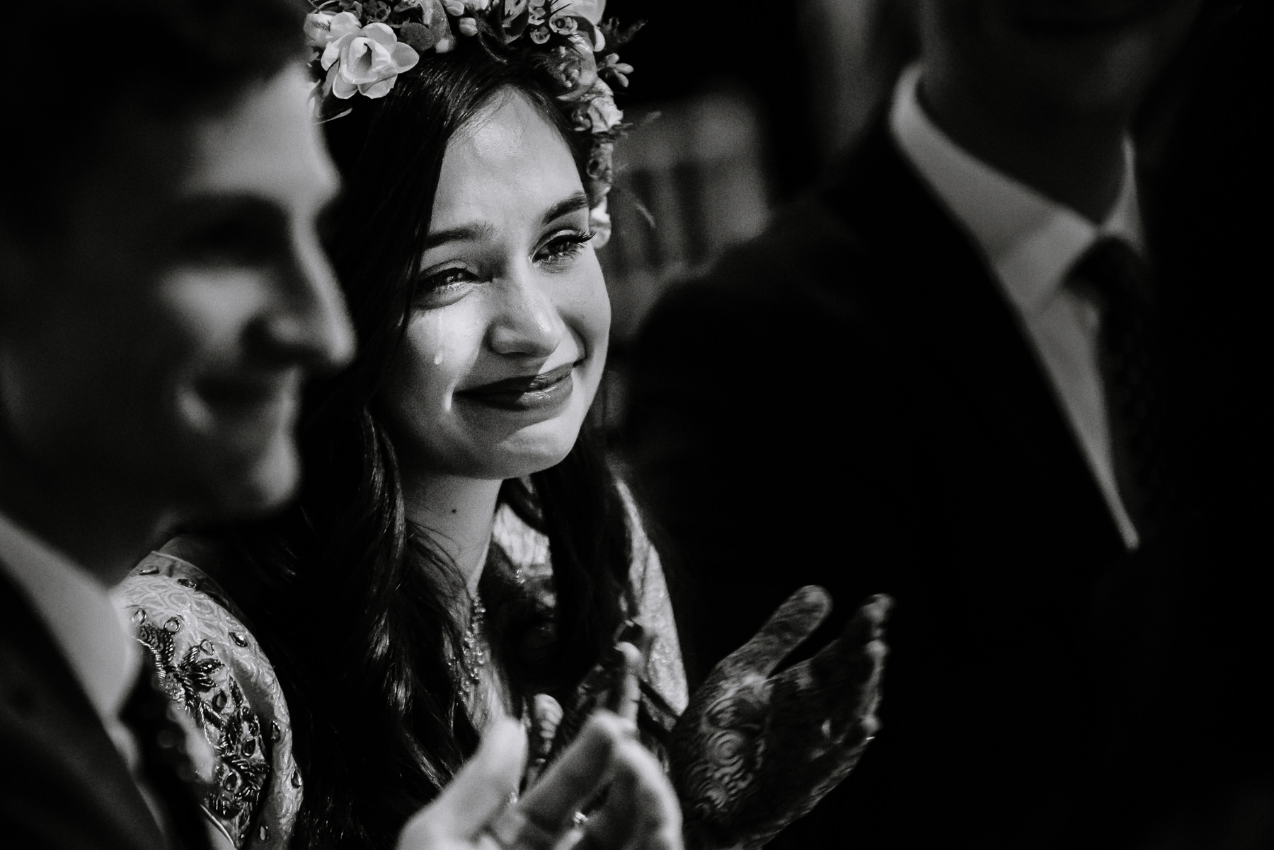 Tear rolling down the cheek of Zara during the speeches on her wedding day at Quarry bank mill.
