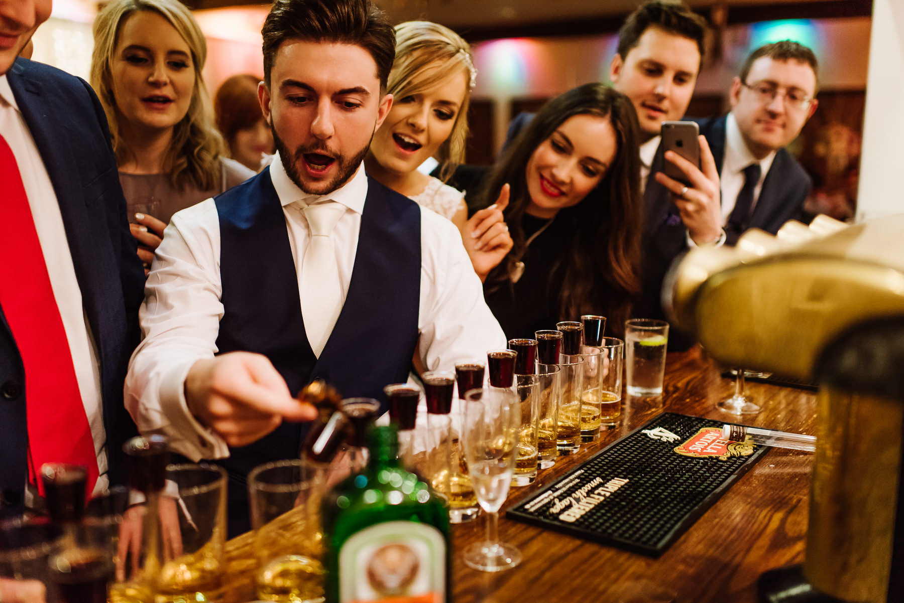 Katie and Sam drinking jaegerbombs on their wedding day