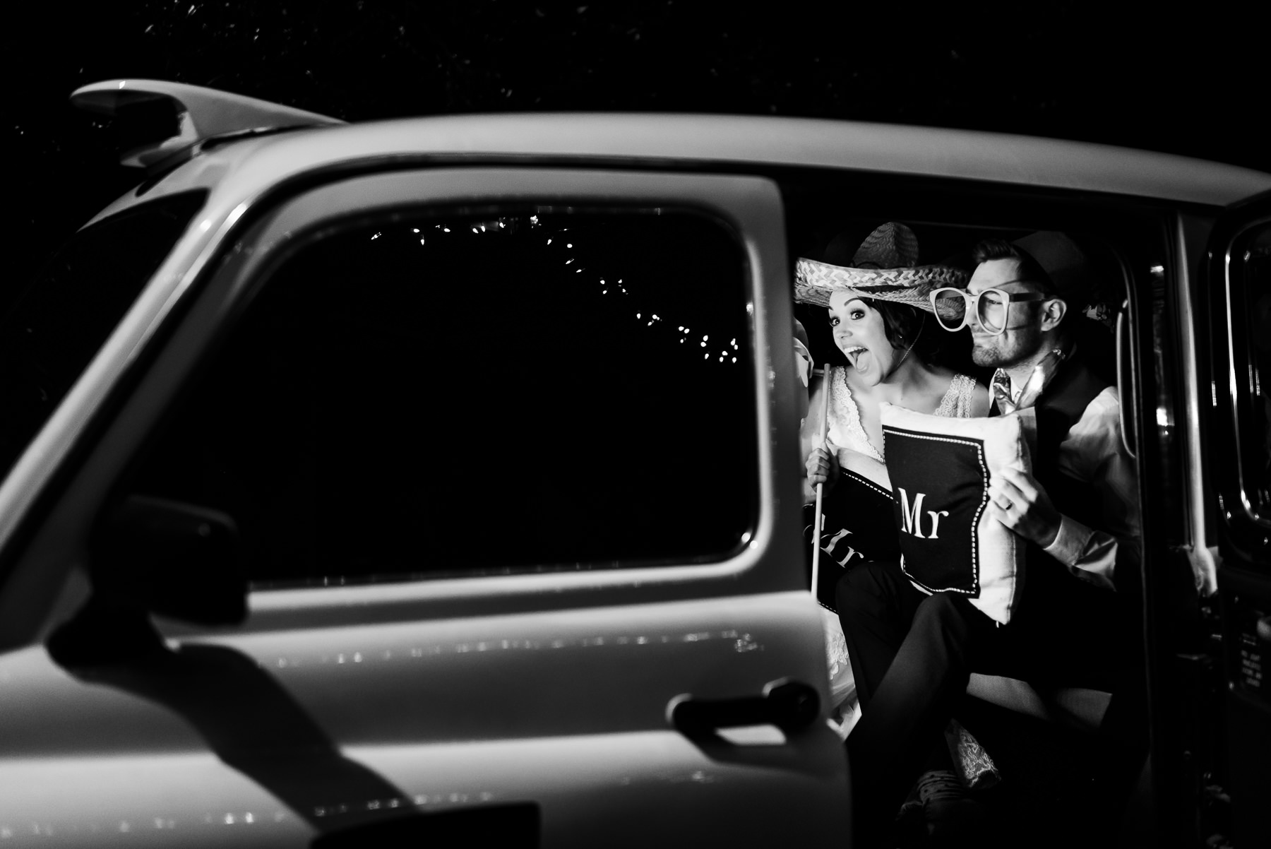 Emma and Danny in their taxi photobooth at Ashfield house on the big day!