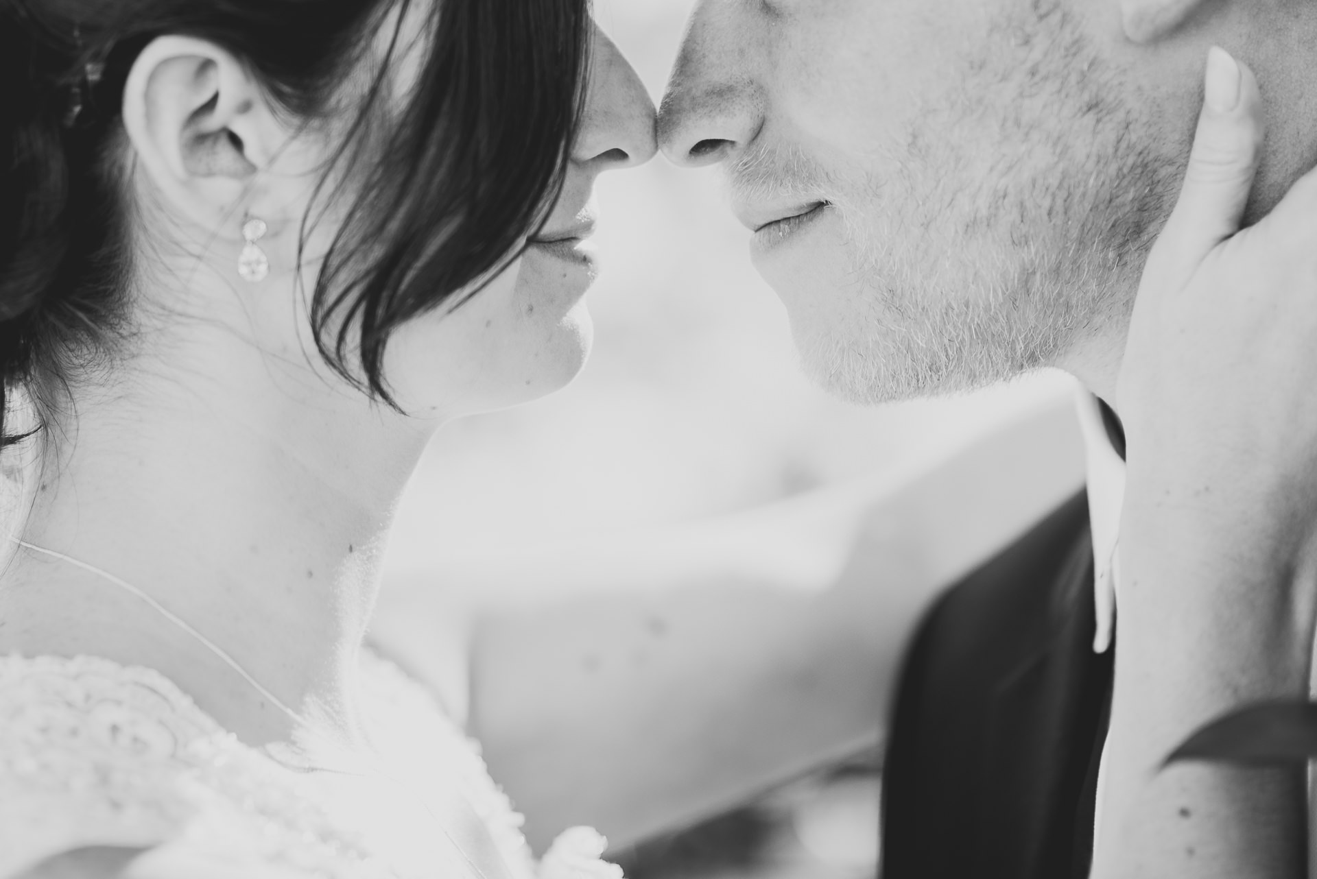 Touching noses in a romantic moment by a bride and groom at Charnock Farm Leyland Lancashire
