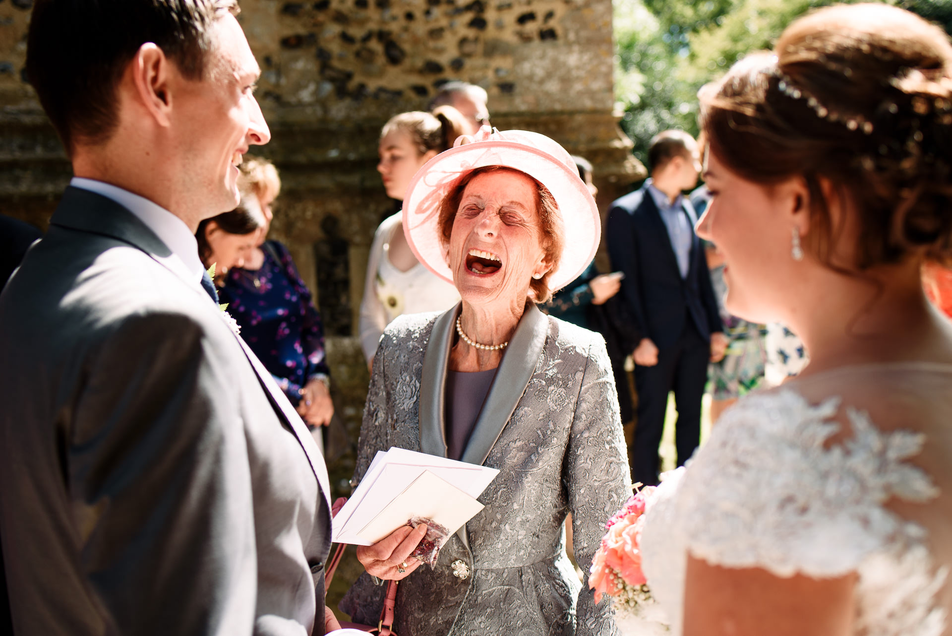 A grandma laughing at her grandsons wedding