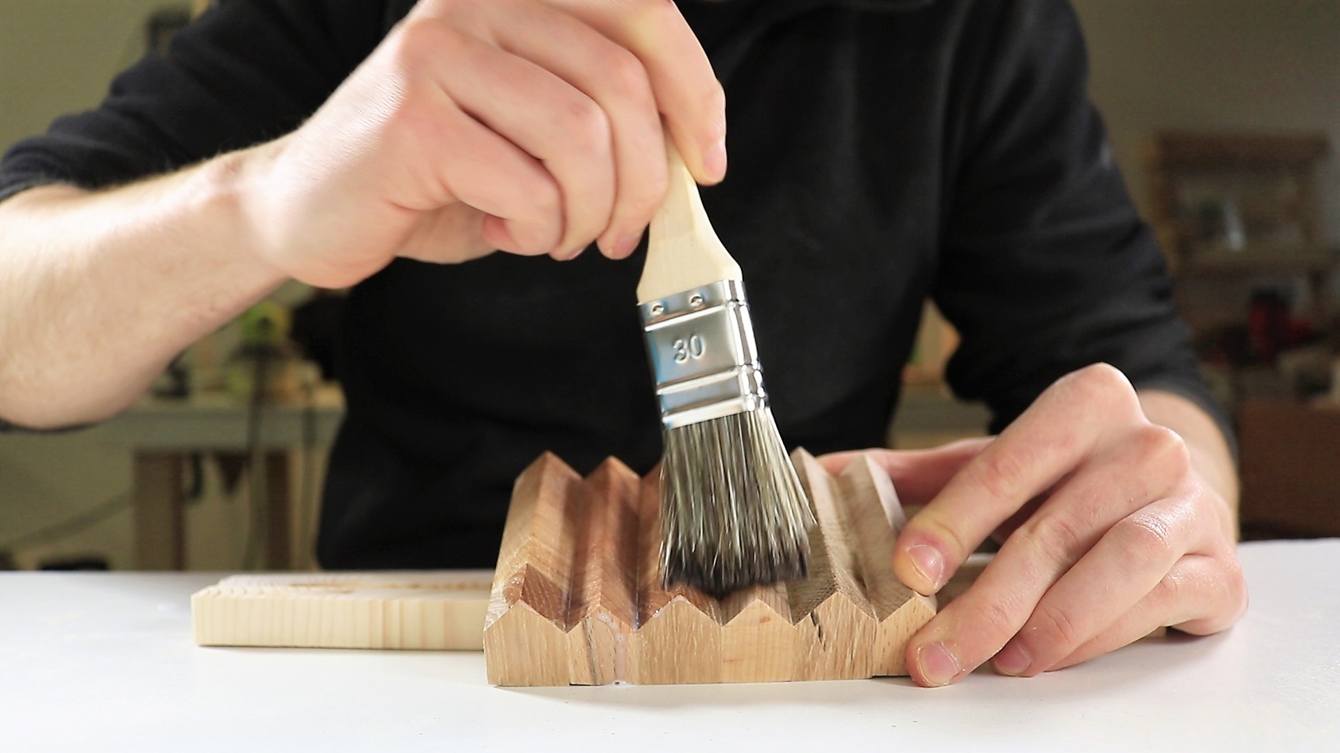 Polish with wood polisher. Let it dry and repeat after sanding with sanding paper with the grit of 120.