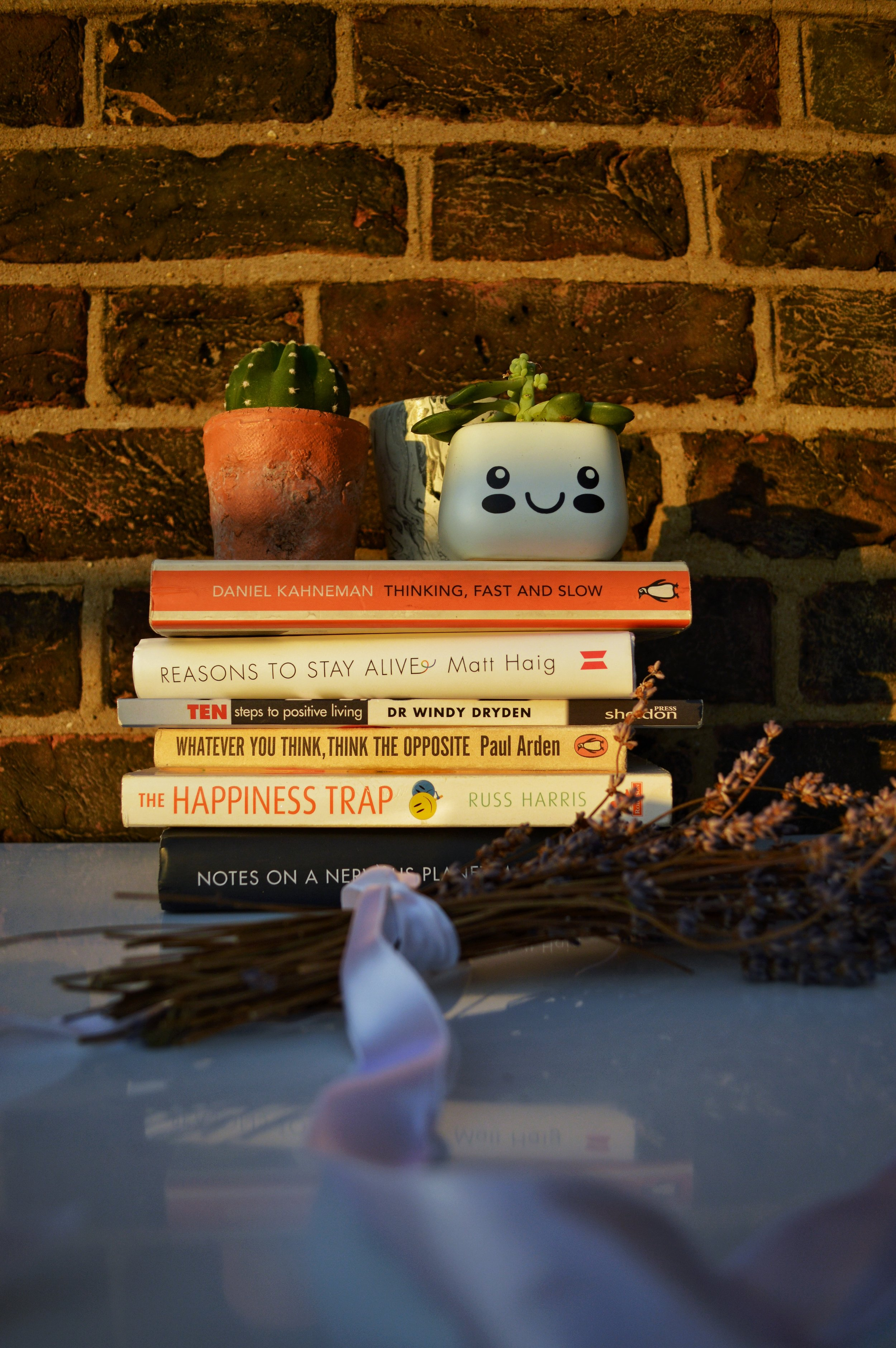 Stack of books and plants