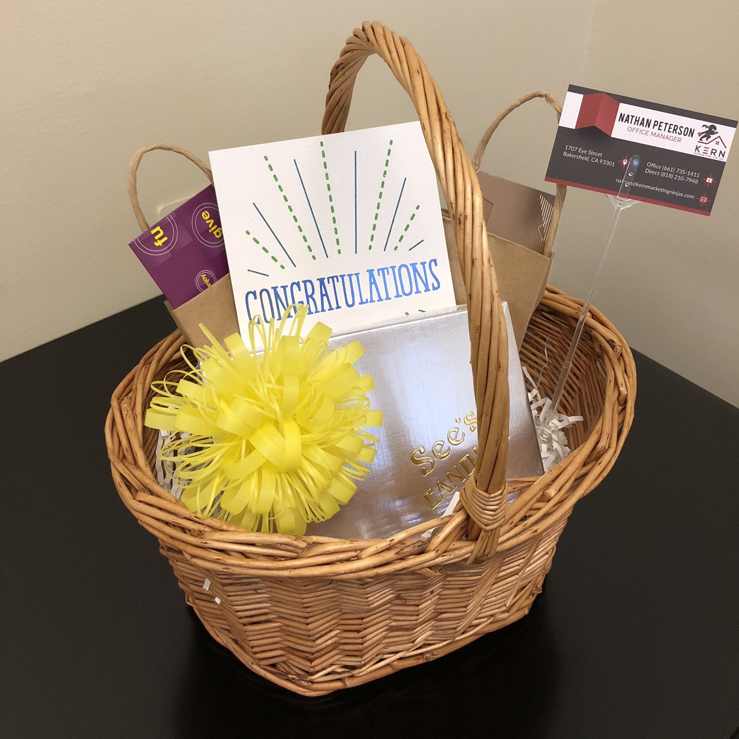 Client Gift Basket - Congratulate your clients with one of our wonderful gift baskets! It's a great way to show you care and is filled with the things they will actually appreciate.