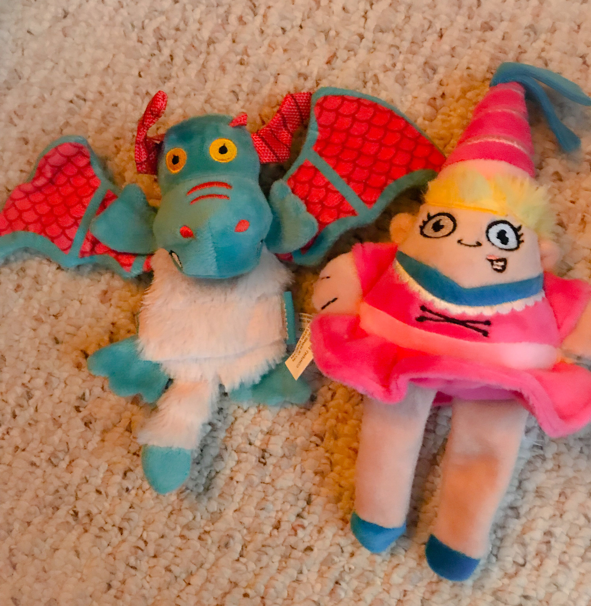 Fairy Land Themed toys. A dragon stuffed with crinkly paper and a squeaker, as well as a princess that makes a funny squeaking sound.