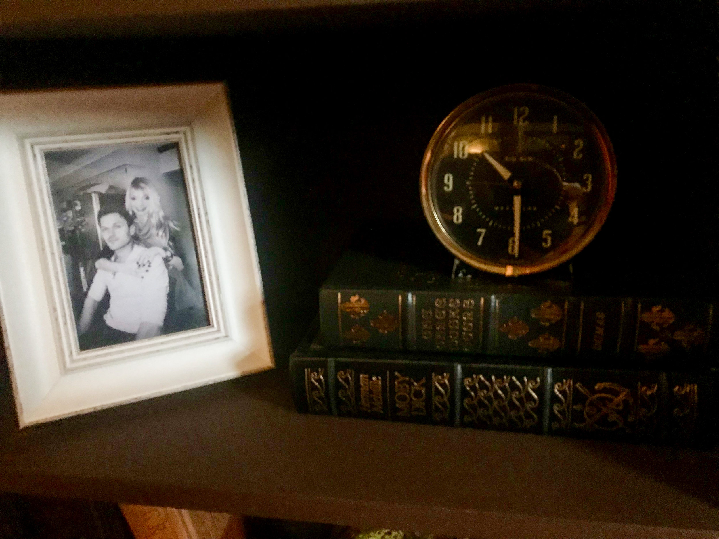 Incorporating a photo of Terry and me in a new frame with vintage books and a vintage Big Ben clock on the bookshelf.