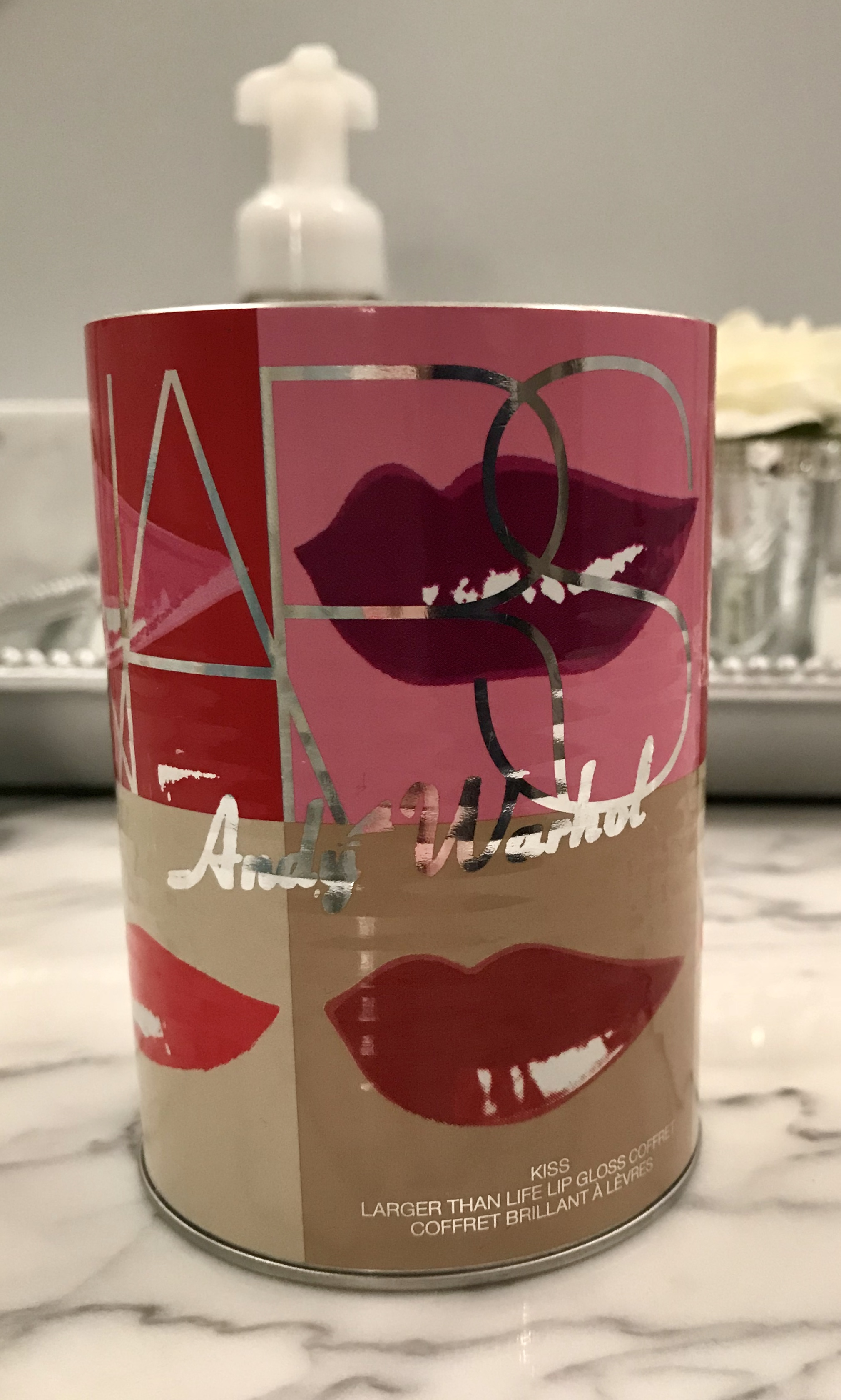 I kept this fun Andy Warhol inspired NARS can from a lipgloss set several years back.  I still love it and never used it.  I  decided to use this for my eyeliners and lipliners.