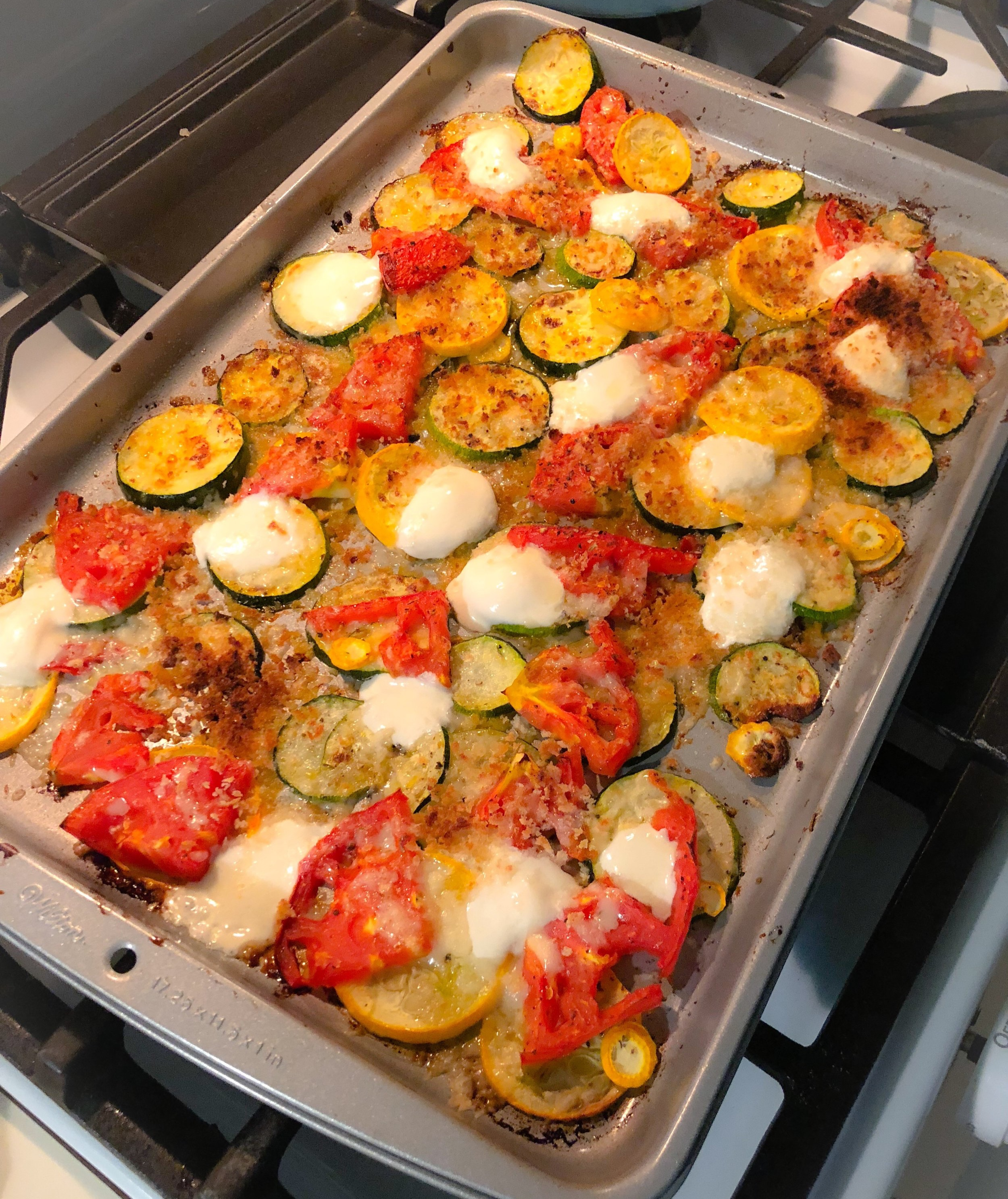 Pan roasted summer squash, zucchini, and tomatoes with broiled mozzarella and parmesan -
