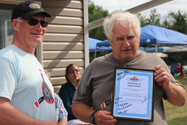 Mike Anderson made a special presentation to Larry Ingram, an area photographer who has captured over half a million images taken at RC events over the last ten years or so. Larry will hang up the cameras for model plane events on Aug 24th at the Stetsons Giant Scale Rally in Ottawa.