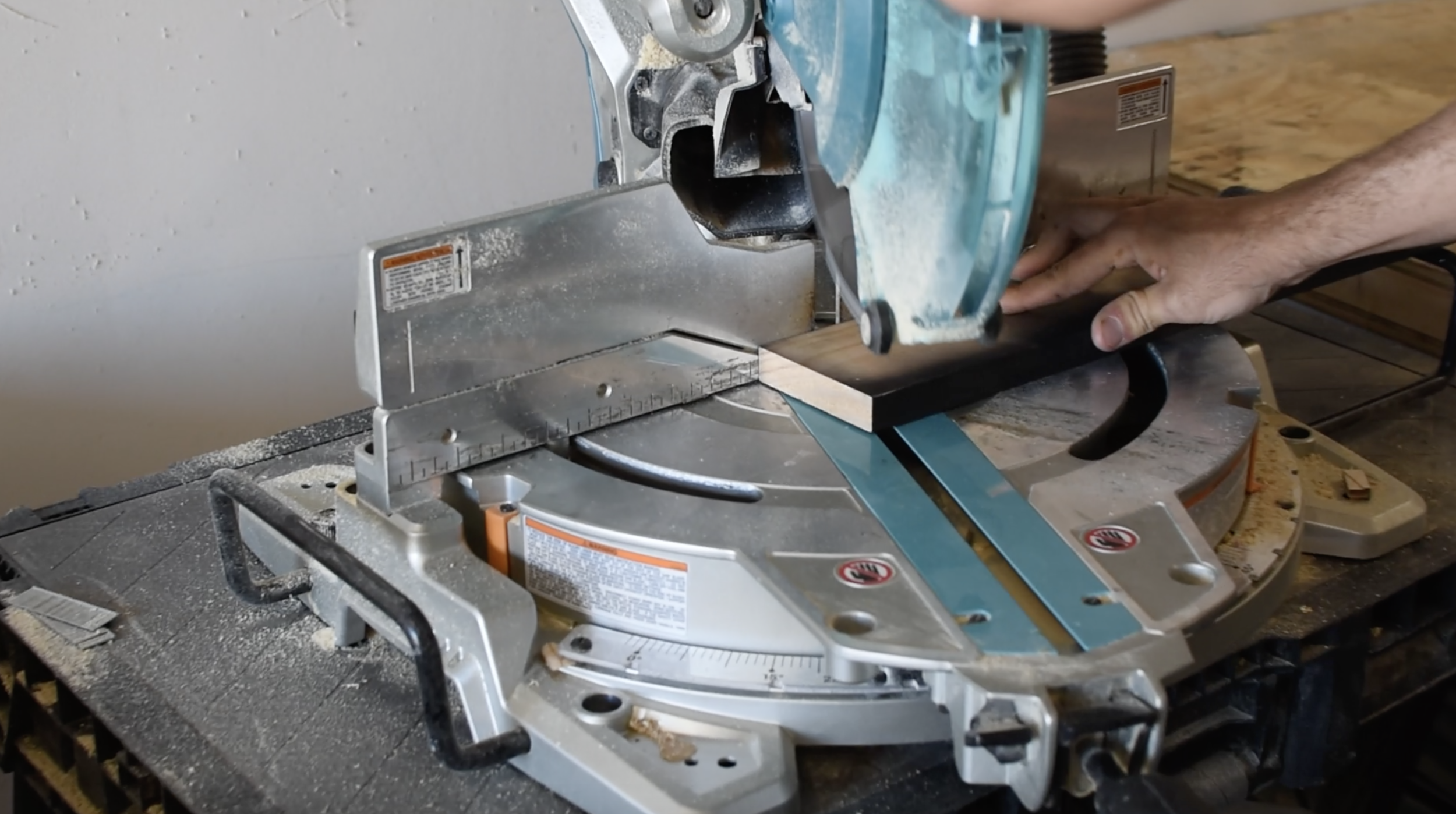 STEP 2 - Set your miter saw to 22.5 degree and make the first cut from the end of the 1x6. Place the cut end of board on the middle line of the plywood backer. Make a line where the board meets the edge of the plywood. This will give you the length of where you need to cut it