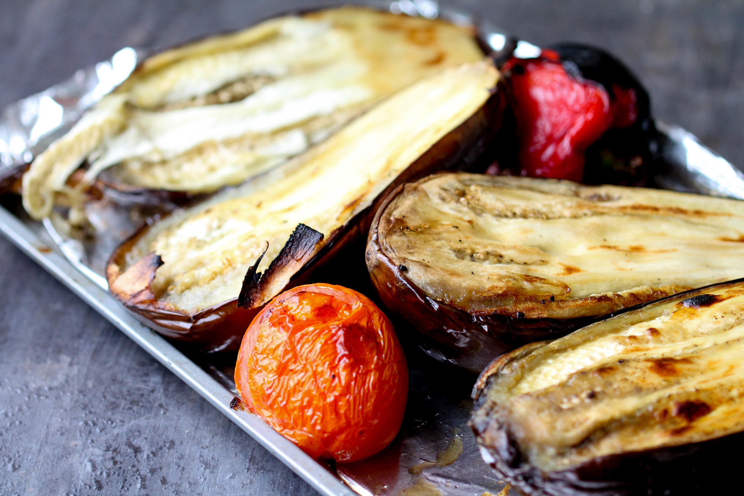Naturally Vegan, Gluten-Free Roasted Eggplant, Bell Peppers, and Tomato Salad! It works great as side, filling for a quick wrap, or use it as pizza base