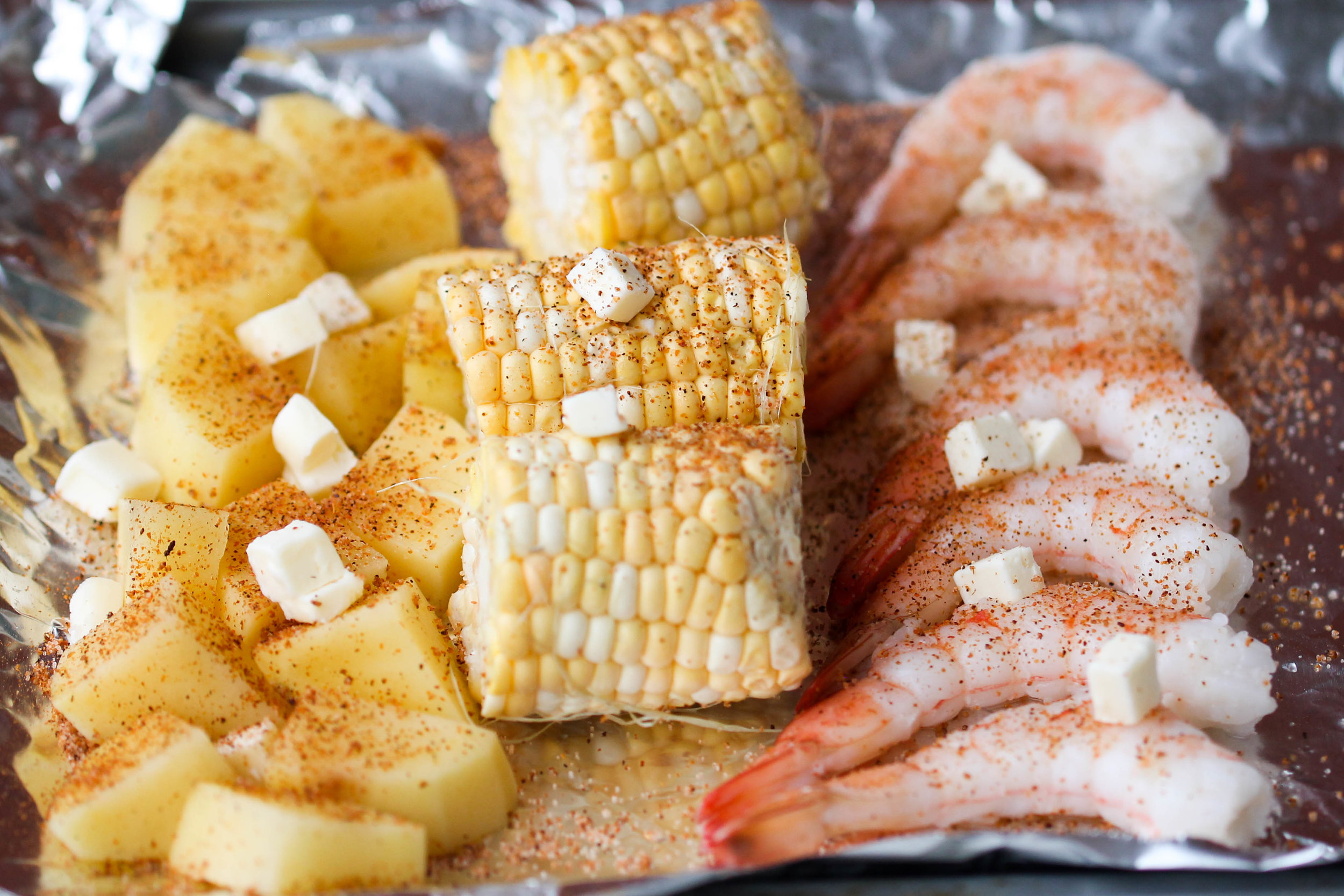 Oven baked Shrimp Boil is an easy dinner-friendly dish that can be enjoyed within less than an hour! Requires very little preparation, few ingredients, and pretty much no clean up.