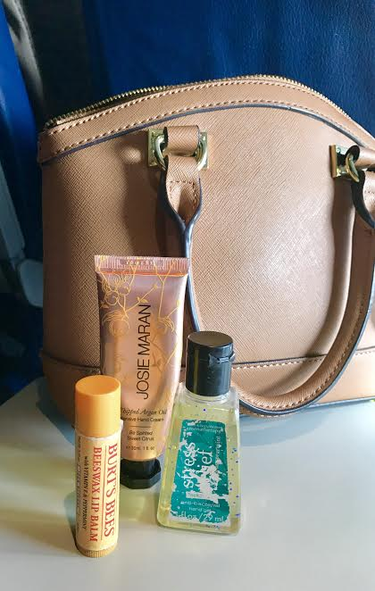 - Travel-Size Toiletries : Travel-size toiletries (2 oz) such as hand lotion, chap stick, and sanitizer are a MUST! I also carry my fav. rollerball perfume & hand and face wipes.