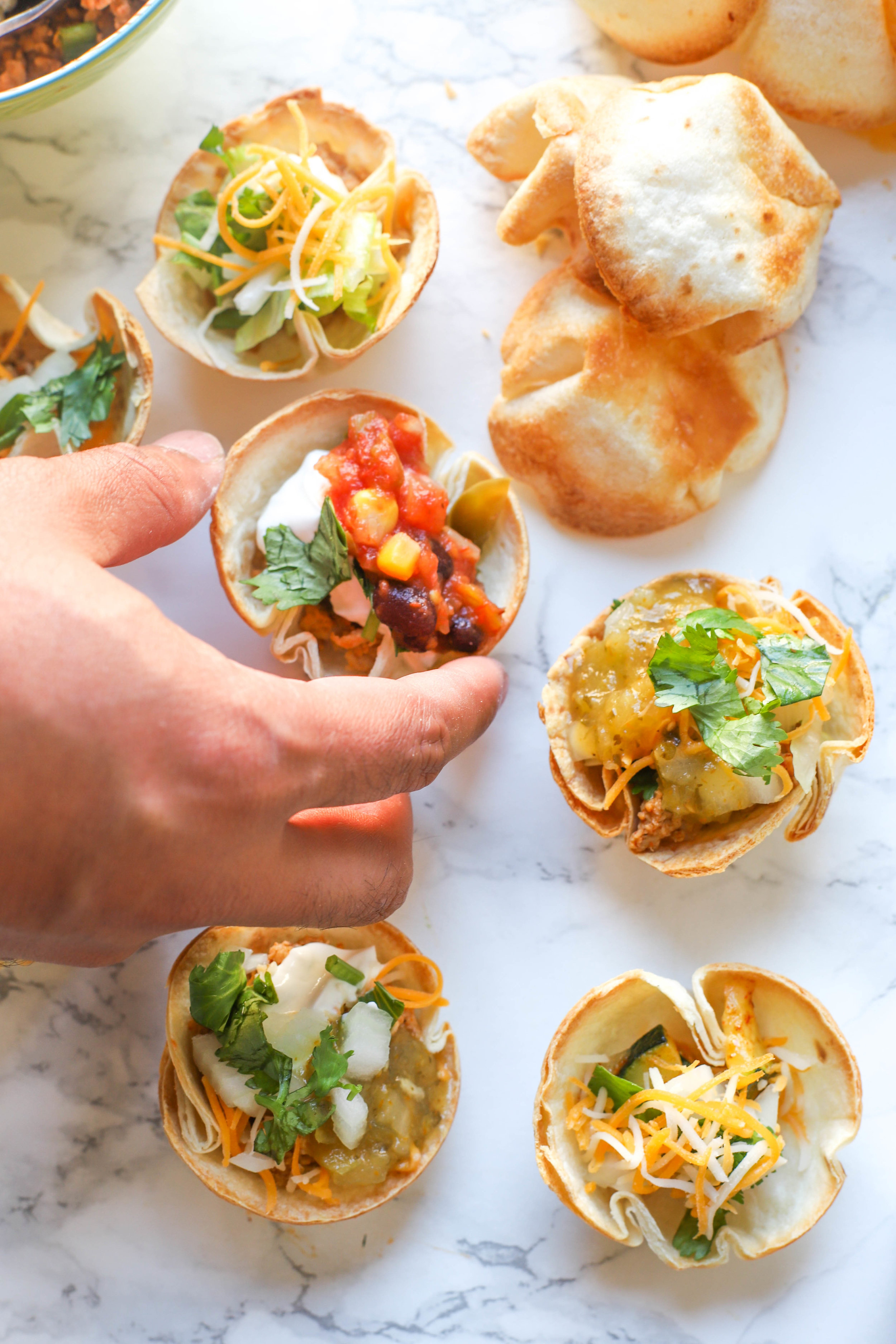DIY Taco Cups are easy & fun spin on traditional tacos with endless options for everyone including vegetarians, vegans, and gluten-free individuals!