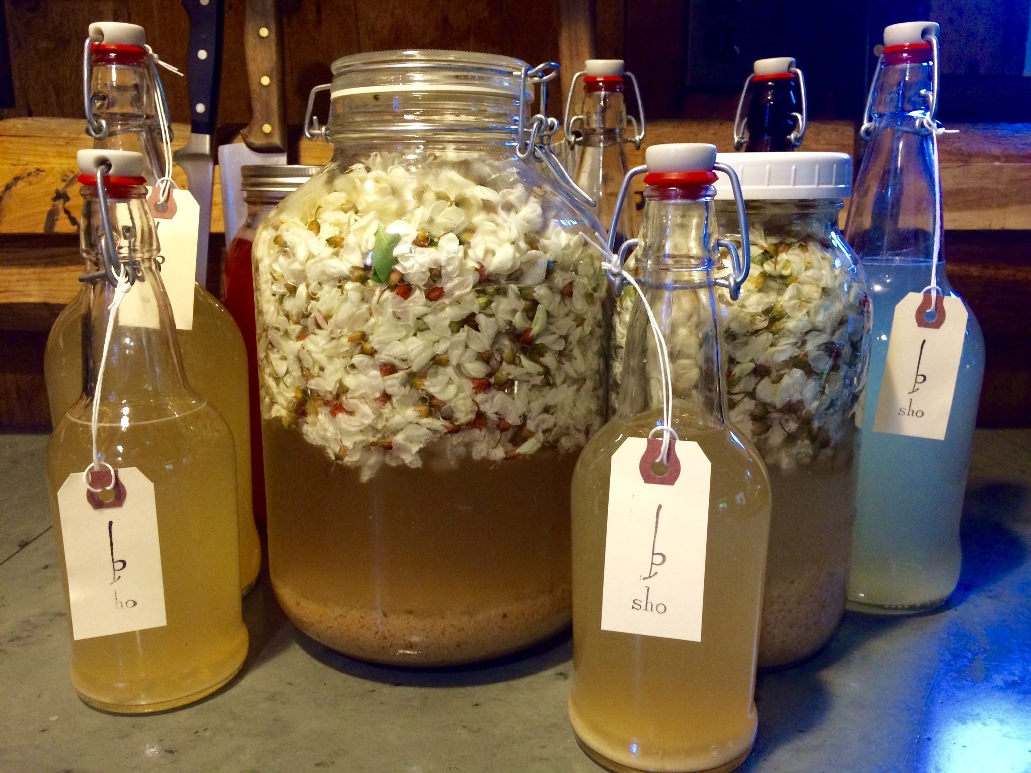 Probiotic water kefirs combined with seasonal flowers...black locust, creates a champagne-like drink with healing properties and unusual flavors. Each drink makes time stand still, with ephemeral flowers preserved in a delicious and aromatic beverage.