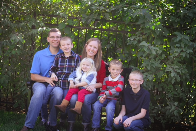 Ann Heckman, D.D.S. with her four children and husband. The perfect WDC- she is a dentist and a mom all at the same time!